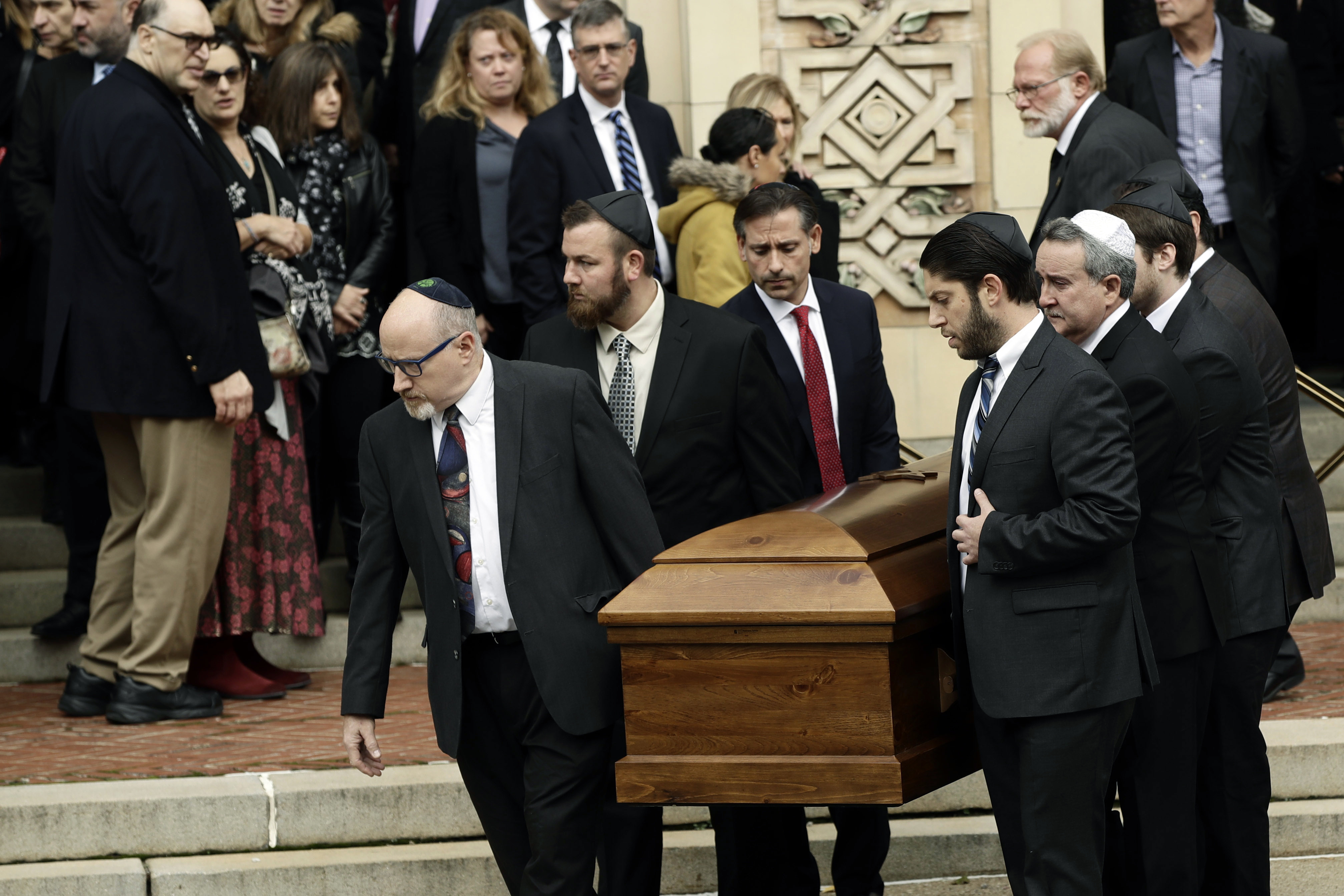 A casket is carried out of Rodef Shalom Congregation after the funeral services for brothers Cecil and David Rosenthal, in Pittsburgh.