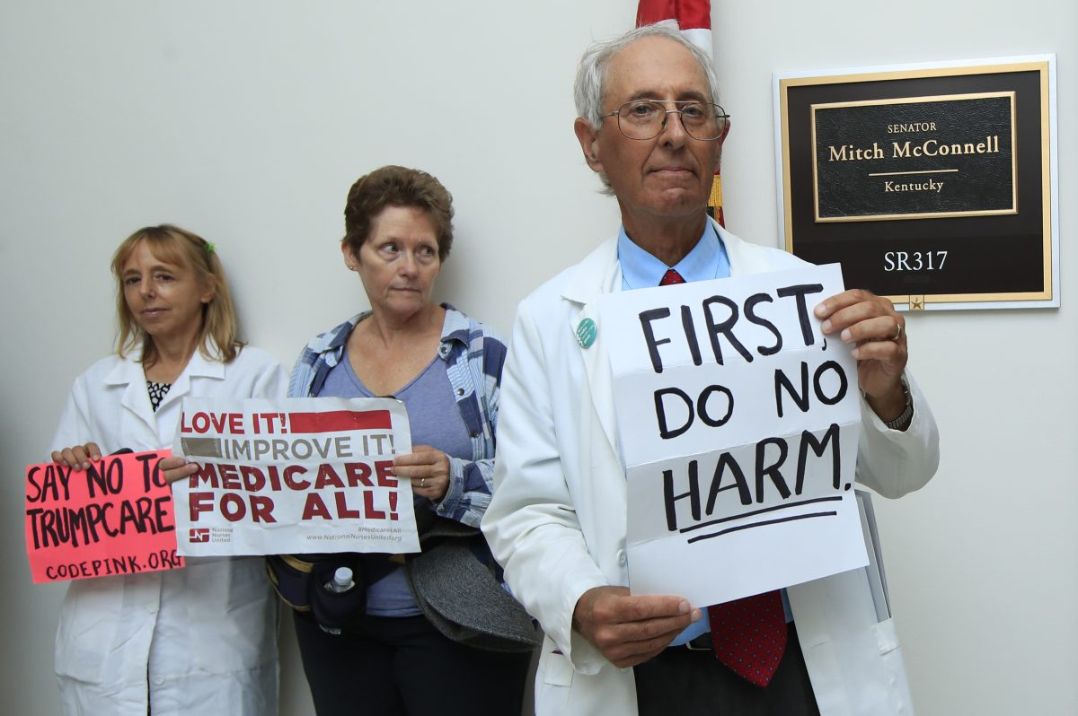 Retired family physician Jay Brock, of Fredericksburg, Va., joins other protesters against the Republican health-care bill outside the Capitol Hill office of Senate Majority Leader Mitch McConnell on Monday.