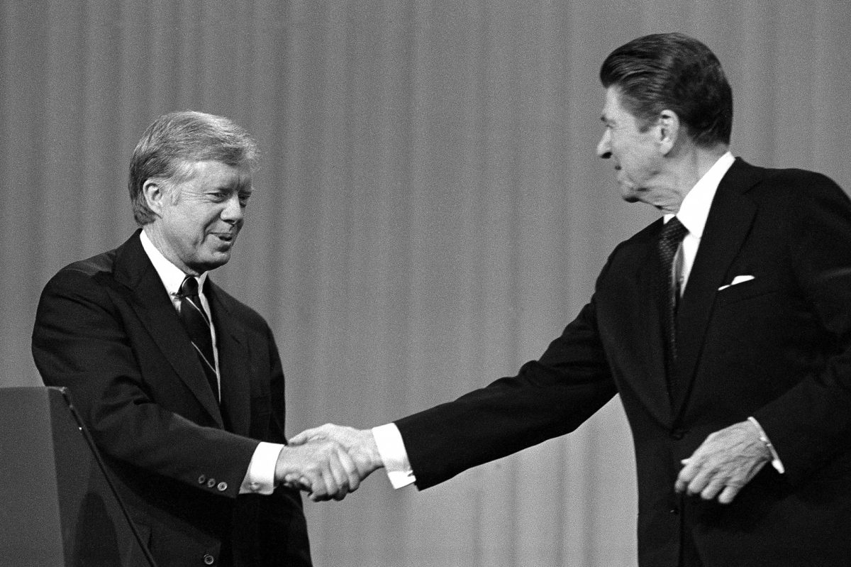 President Jimmy Carter shakes hands with Republican presidential candidate Ronald Reagan after debating in the Cleveland Music Hall on Oct. 28, 1980.