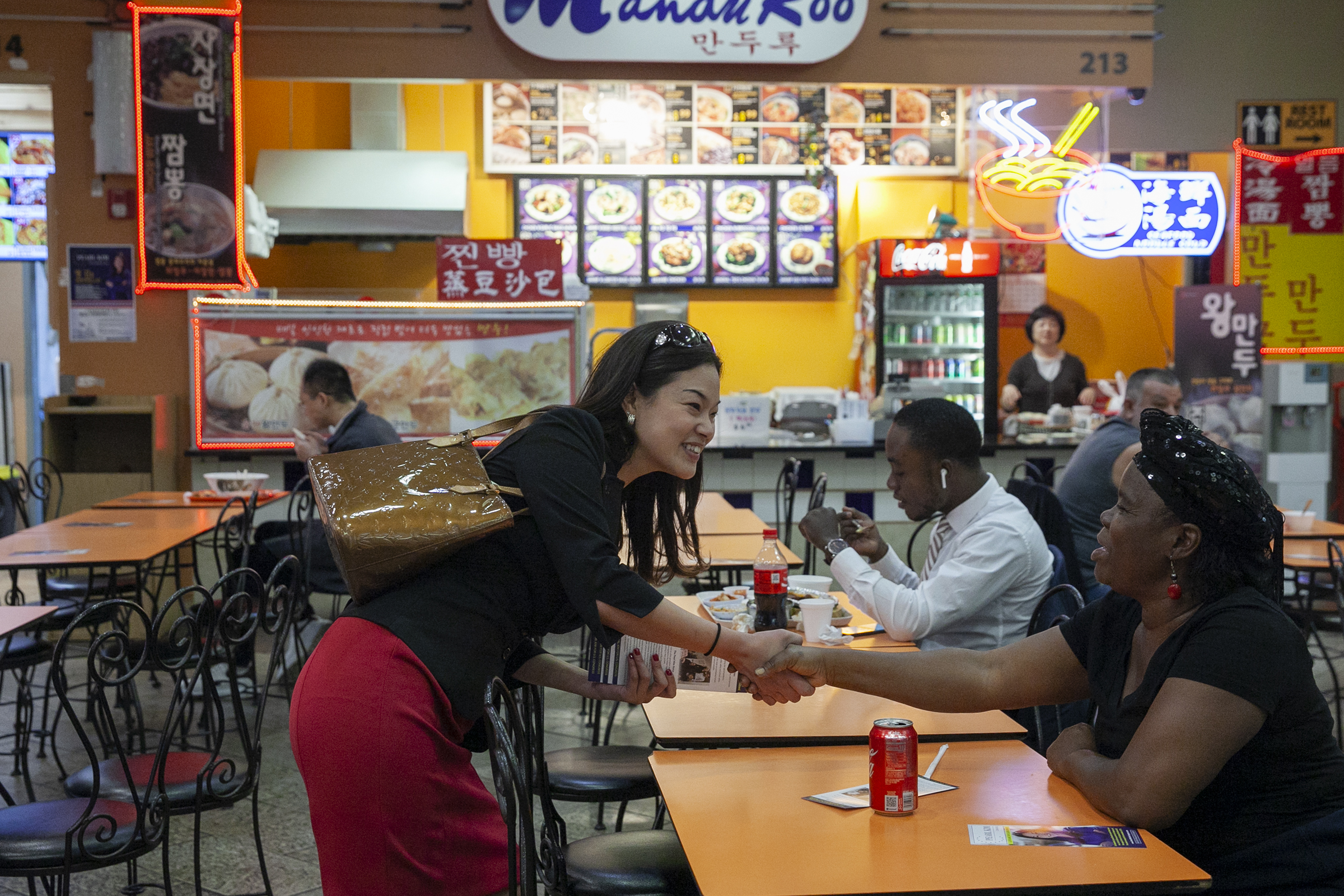 Pearl Kim, Republican candidate for Pennsylvanias Fifth Congressional District, shakes hands with Roselyn Gray, 54, at H Mart in Upper Darby on Friday, Oct. 19, 2018.