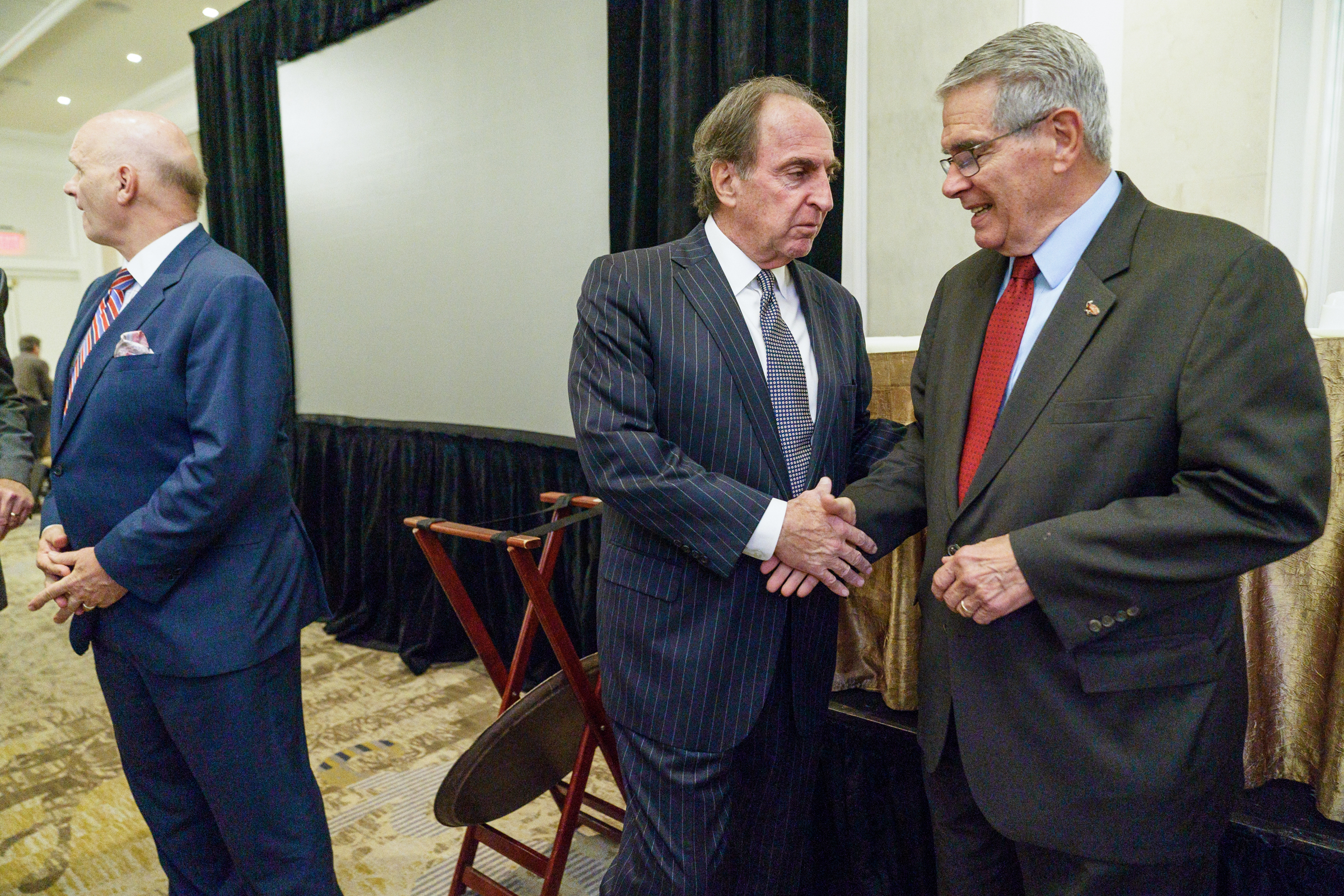 Temple University basketball coach Fran Dunphy, center, shakes hands with Don DiJulia, right, after both men accepted awards at the 7th annual preseason college basketball preview lunch, at the Hilton Hotel in Philadelphia, November 1, 2018. PhiladelphiaÕs six NCAA Division I menÕs basketball coaches and the American Cancer Society hosted the 7th annual preseason college basketball preview lunch. JESSICA GRIFFIN / Staff Photographer