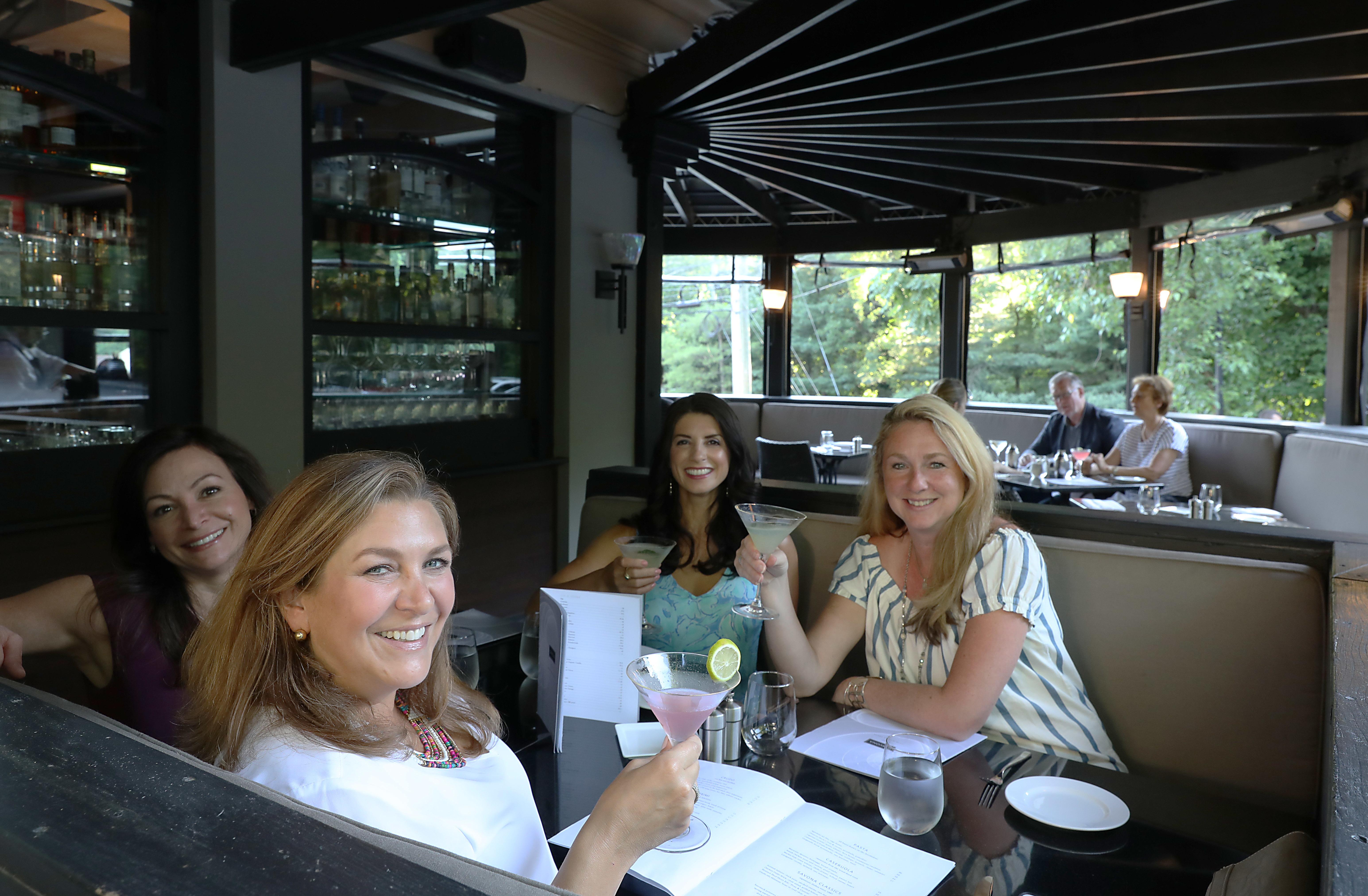 Customers, from left, Melanie Merlino, Lynne Shirna Briggs, Amanda Macielinski, Lynne Sundblad from Wayne, are having drinks at an outdoor table at Savona.
