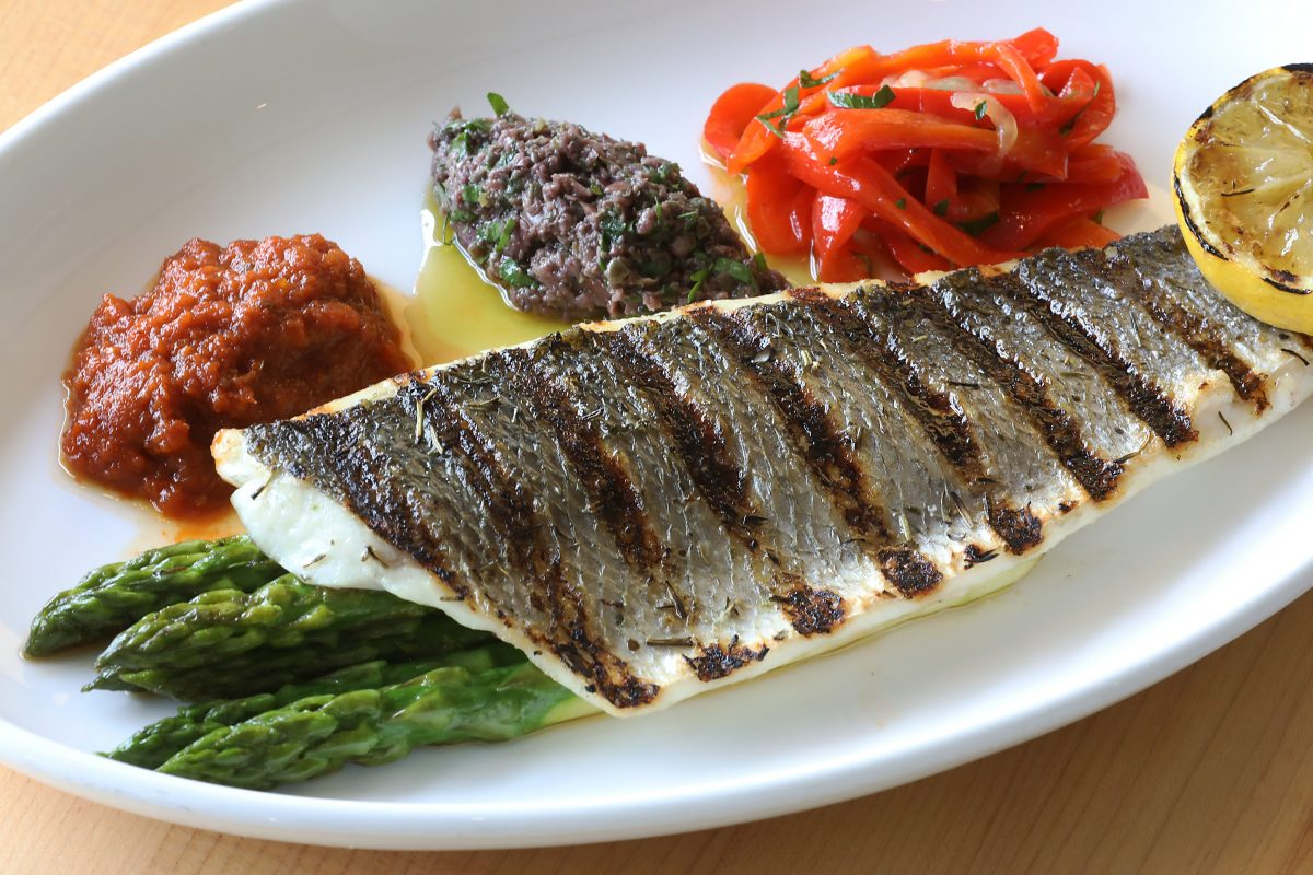 Grilled branzino at Savona with asparagus, tomato compote, olive tapenade and peperonata.