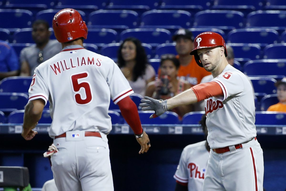 The Phillies´ Nick Williams (5) is congratulated by Daniel Nava (25) after Williams scored on a sacrifice fly in the first inning against the Marlins on Wednesday