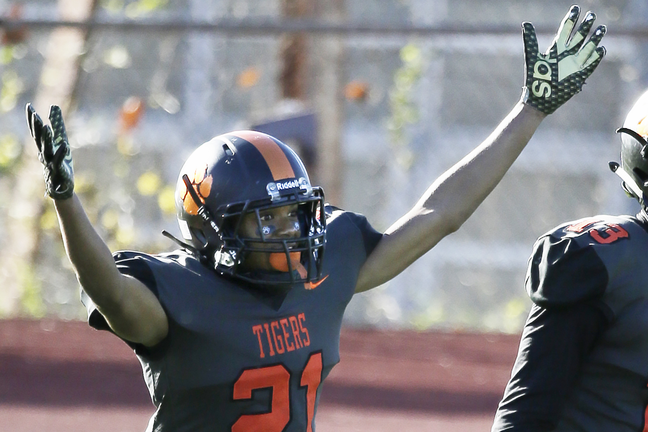 Wilson's Marquay Graves celebrates the interception he returned for a touchdown in the third quarter.