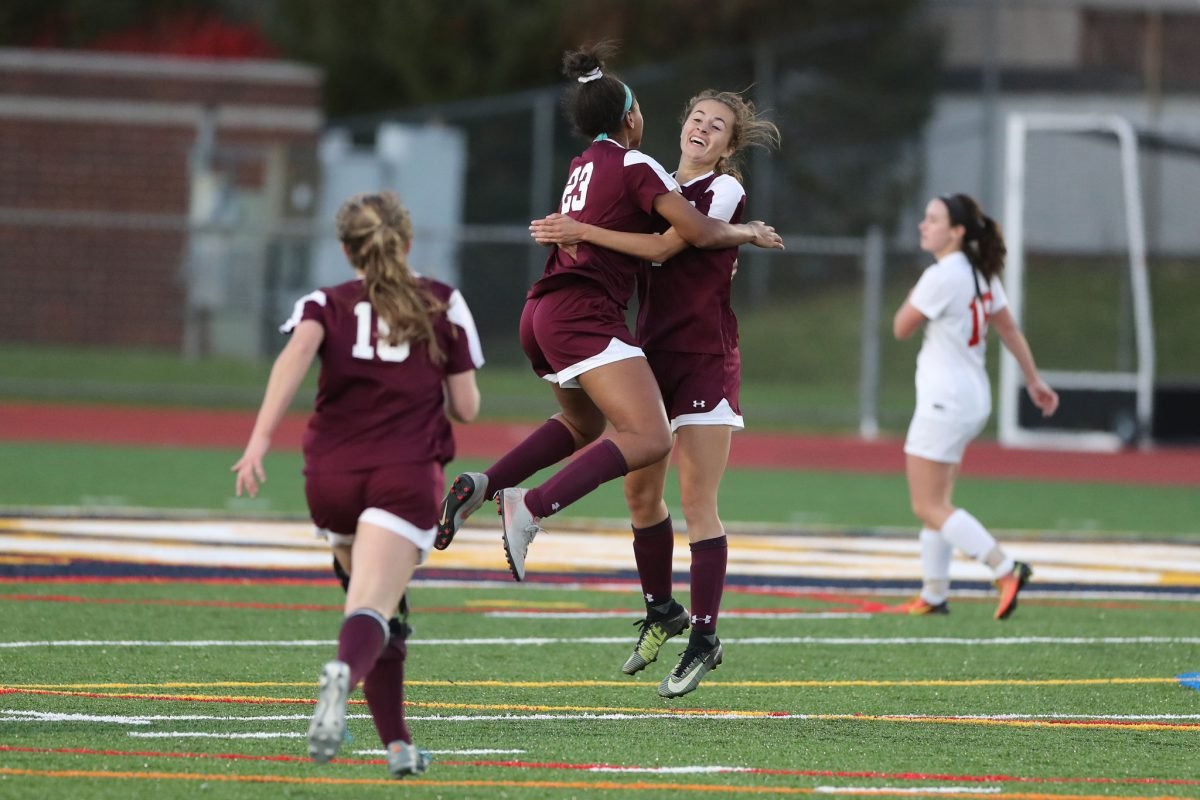 Nia Scott, center, of Conestoga leaps into the arms of teammate Caitlin Donovan, 2nd from right, after Nia scored the game-winning goal in overtime in the  PIAA District 1 Class 4A girls' soccer championship between Souderton and Conestoga on Nov. 3, 2018.    Emily Wertz is left.  Conestoga won 2-1.