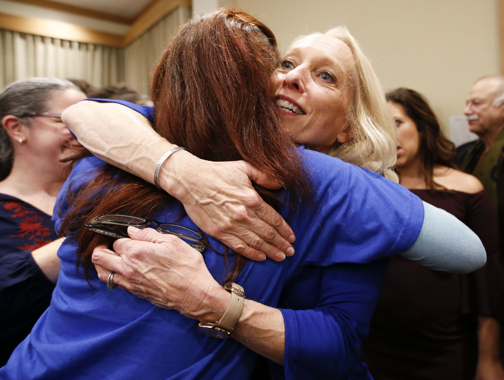 Mary Gay Scanlon hugs a supporter at her election watch party at the Inn at Swarthmore on Tuesday.
