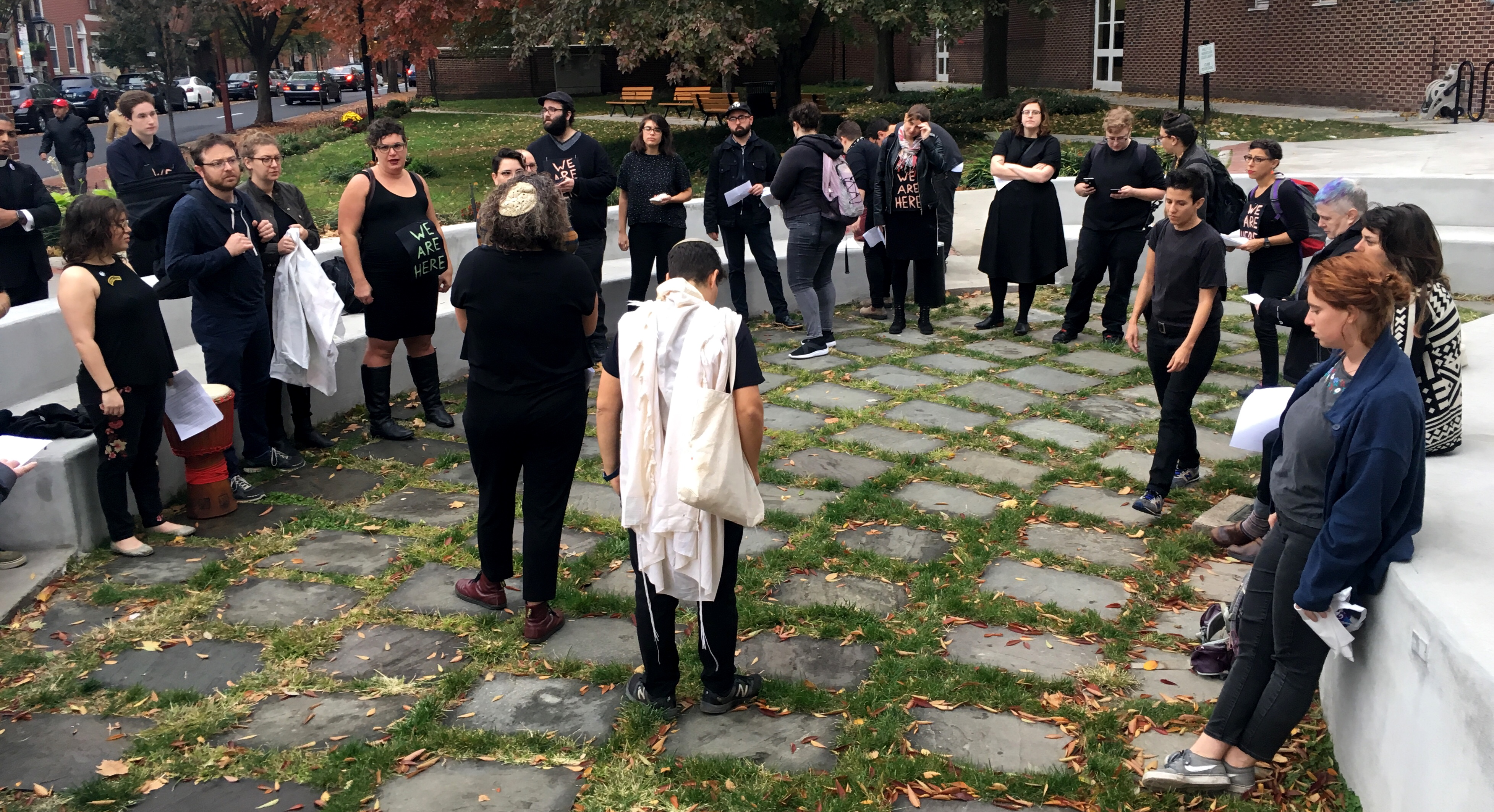 Protesters on Nov. 2, 2018, perform a mourning prayer before a protest at the office of gubernatorial candidate Scott Wagner.