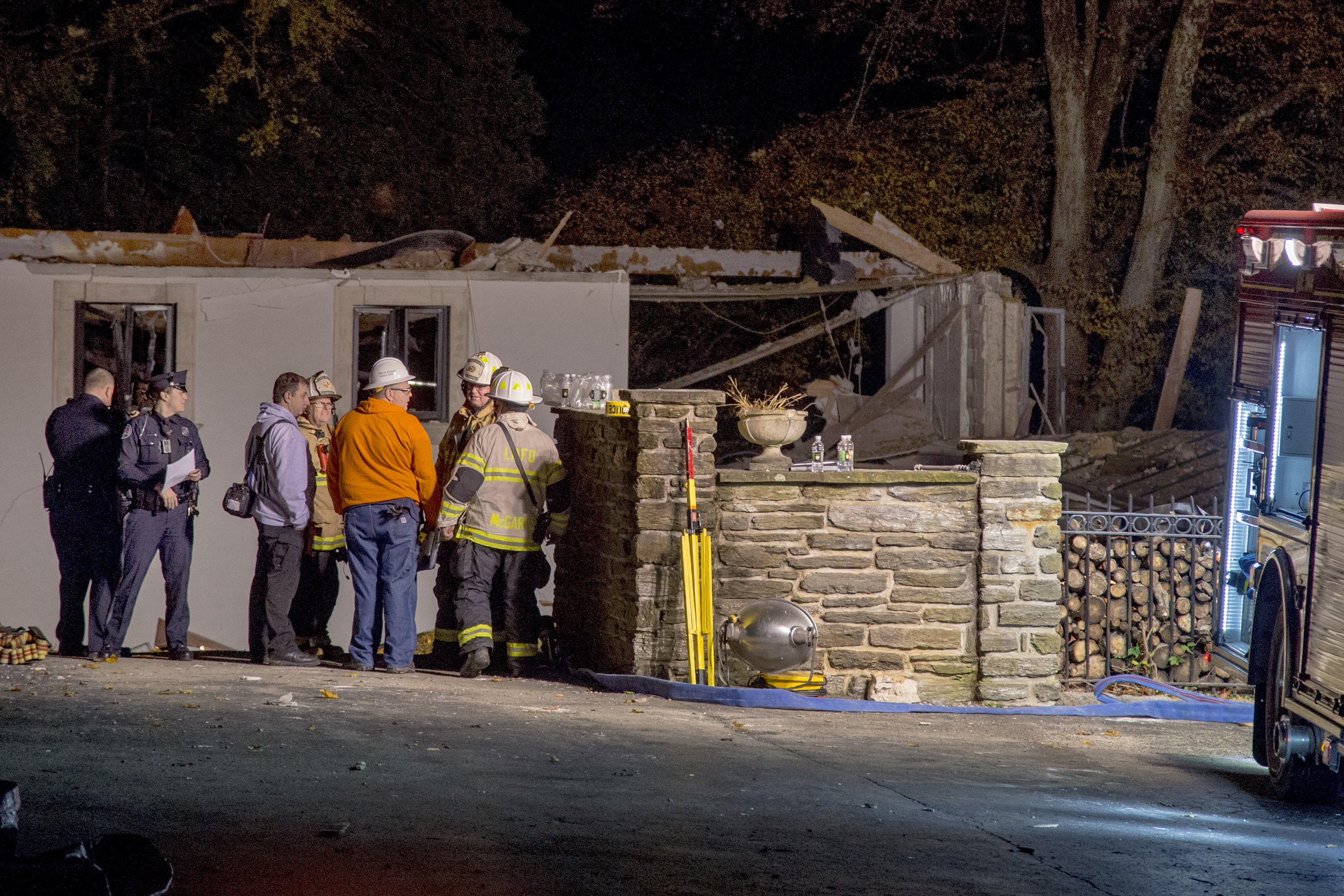 Police and fire officials gather around the leveled home on Dodds Lane in Gladwyne November 4, 2018. The explosion was so loud it could be heard for miles. TOM GRALISH / Staff Photographer