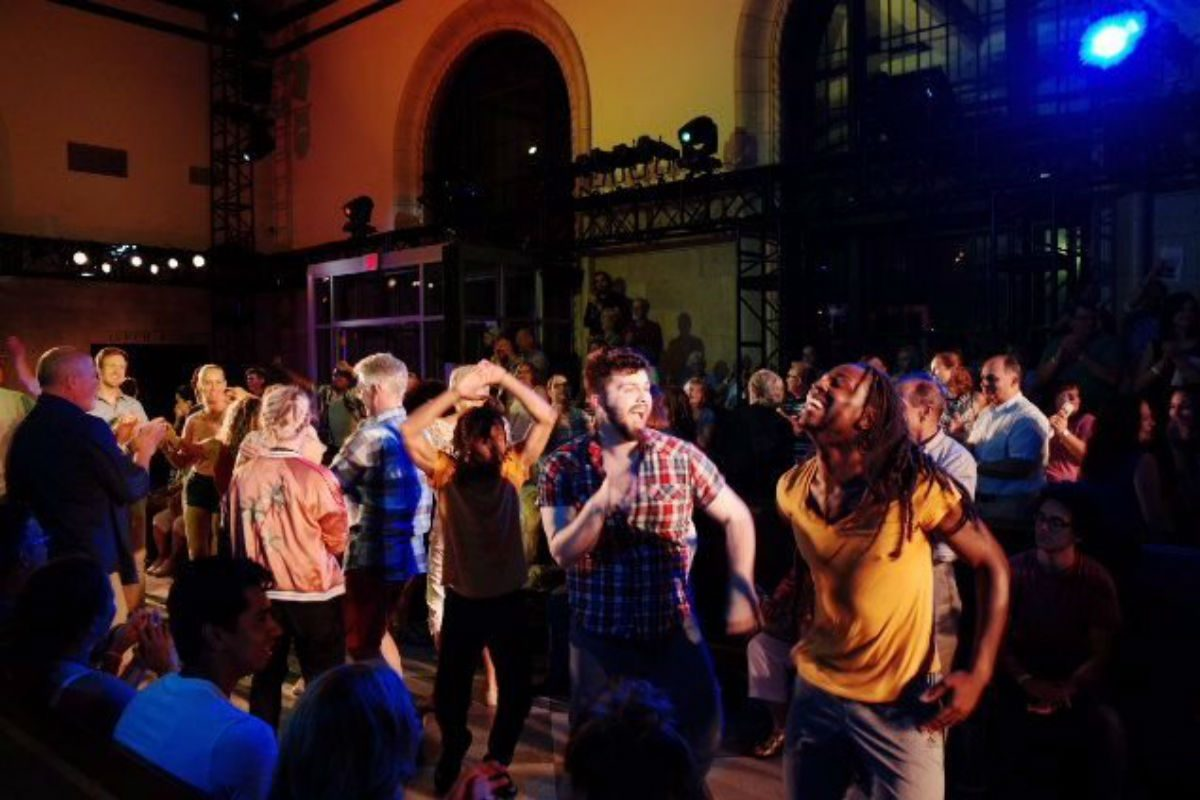 """Performers, Christopher Roche and Jaymes Williams dance with the audience at the finale of the epic installation """"This Is Reading,"""" July 21-23 and July 28-30 at the Franklin Station, Reading."""