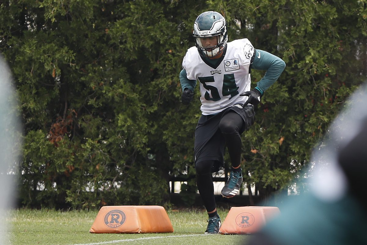 Kamu Grugier-Hill runs a drill during Eagles minicamp in June.