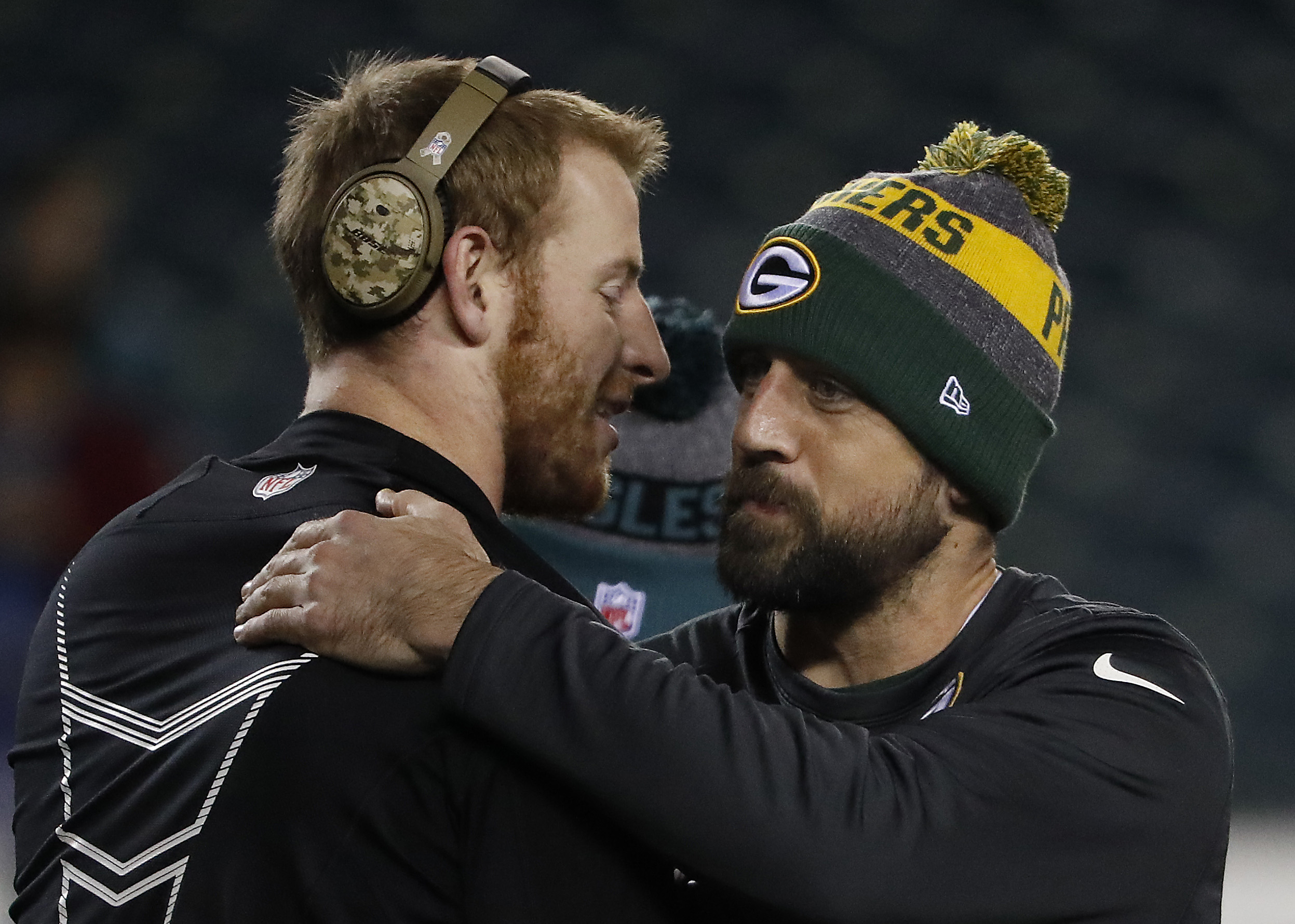 Carson Wentz (left) and Aaron Rodgers embraced before their teams played in November 2016.