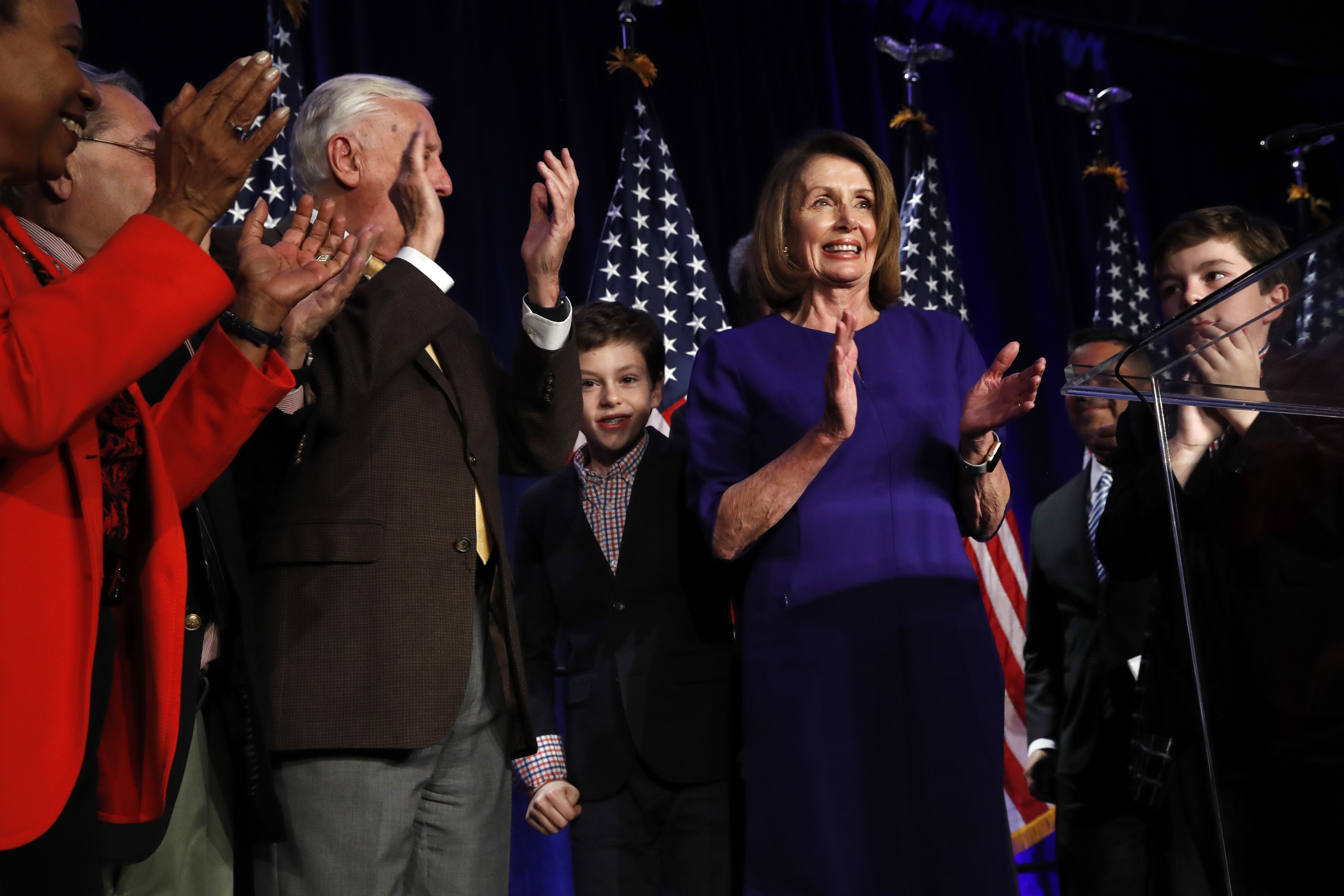 House Democratic Leader Nancy Pelosi on stage after speaking about Democratic wins in the House of Representatives to a crowd of supporters on Tuesday in Washington.