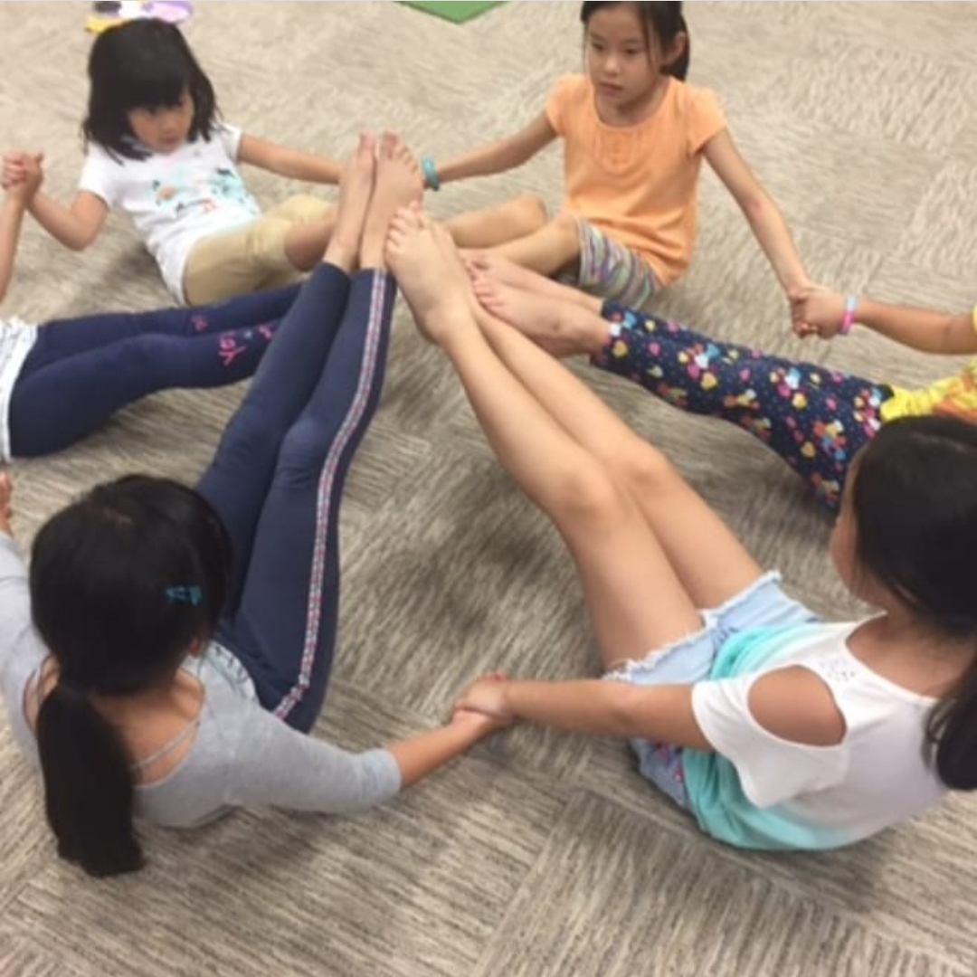A kids yoga class at Downward Dog Dance, Yoga & Wellness in Richmond, Virginia.