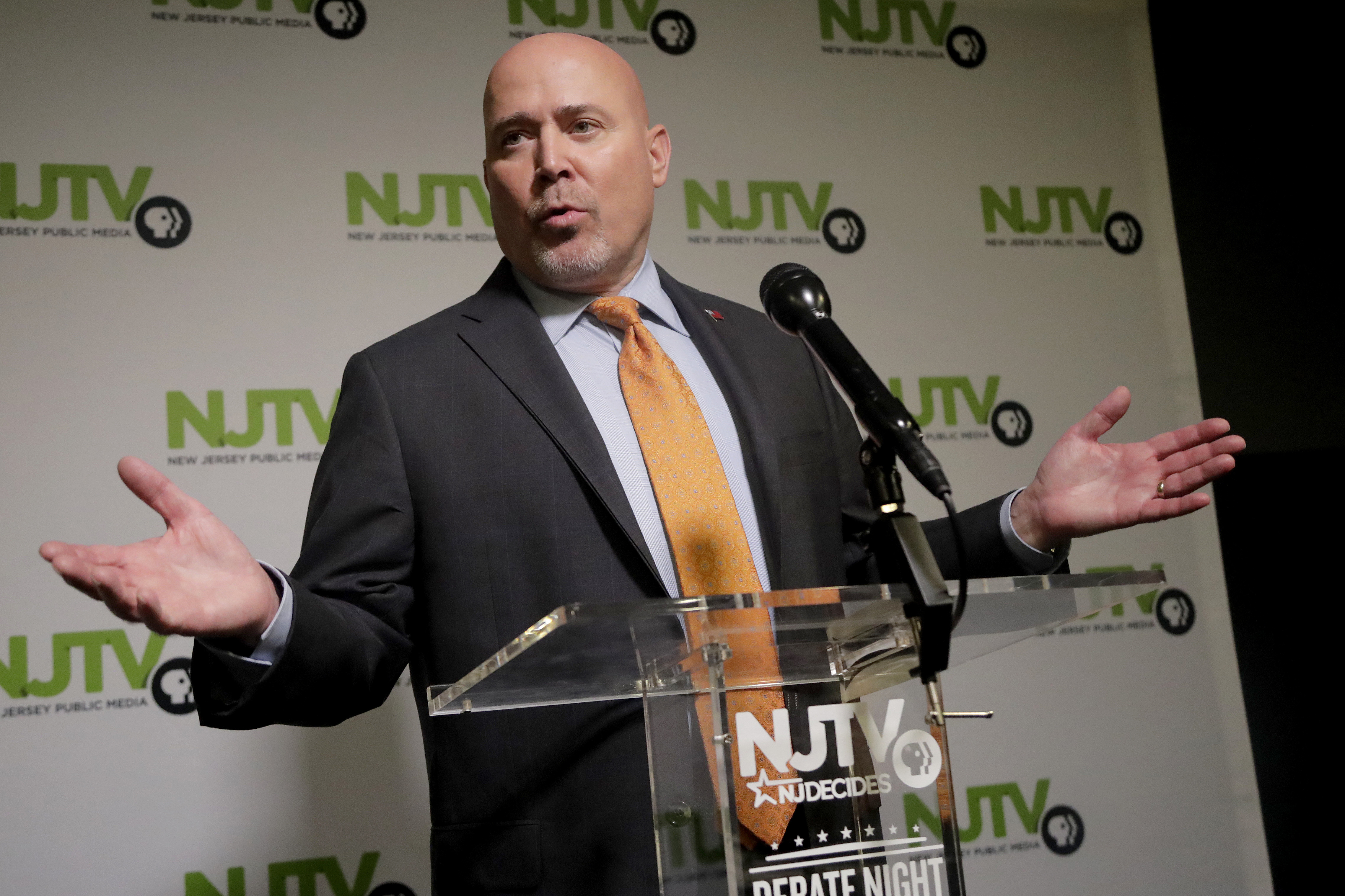 Tom MacArthur, the Republican candidate in the U.S. Congressional District 3 race, speaks to reporters after a debate with Democratic candidate Andy Kim, Wednesday, Oct. 31, 2018, in Newark, N.J. (