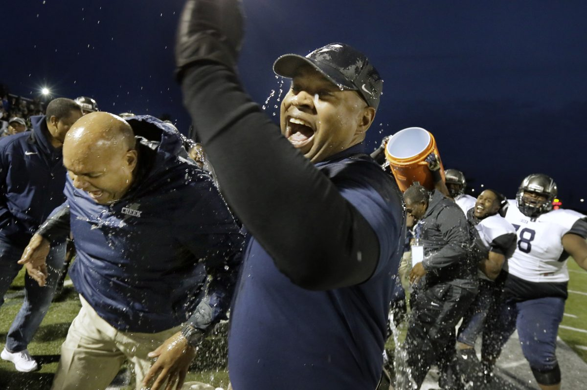 Timber Creek football coach Rob Hinson is doused with water in the closing seconds of the team's 31-10 win over Lenape in the South Jersey Group 4 title game in 2016.