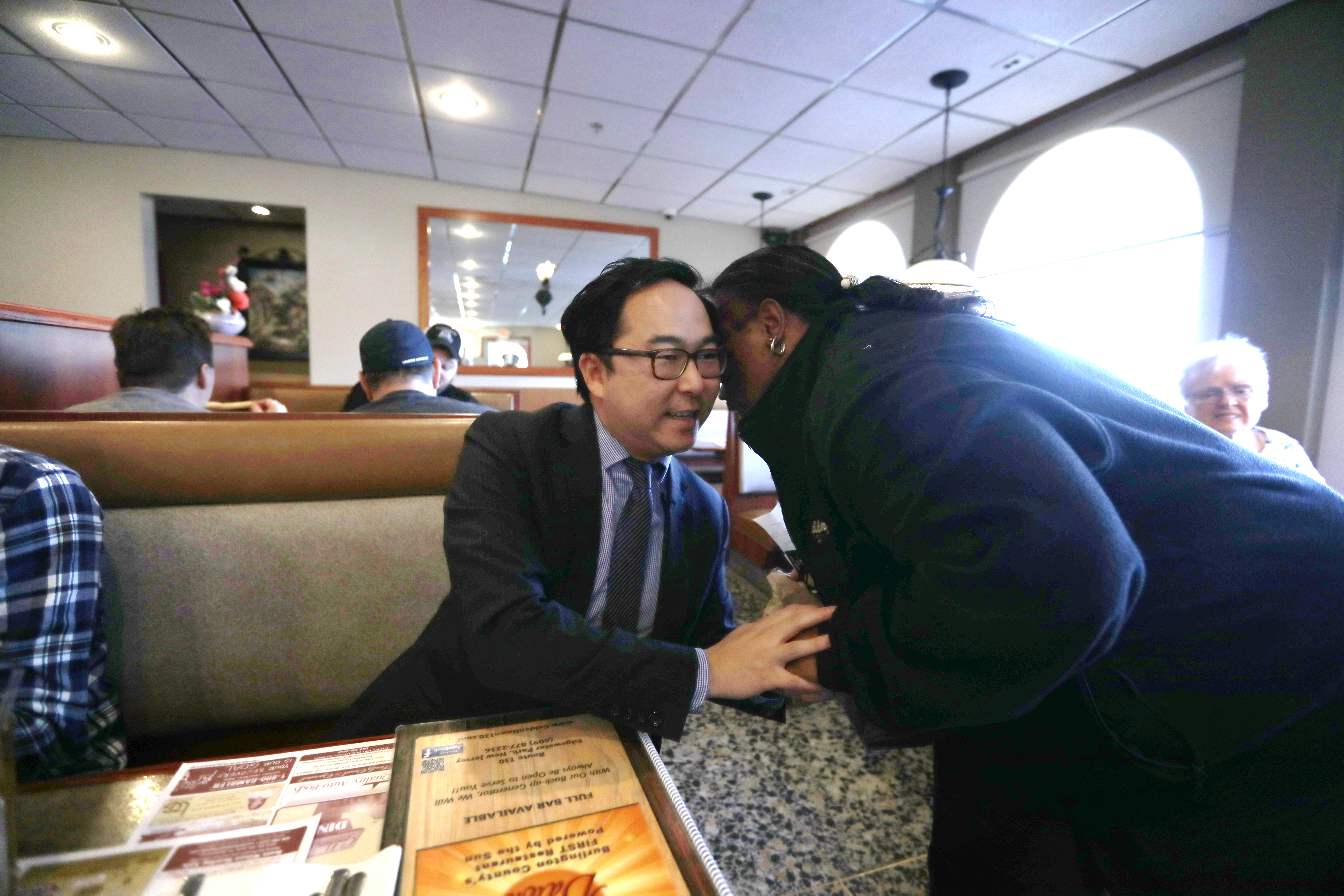 Congressman Andy Kim (D), NJ sits at the Golden Dawn Diner in Burlington and meets constituents including Shirley Leary, 59, Thursday November 8, 2018.