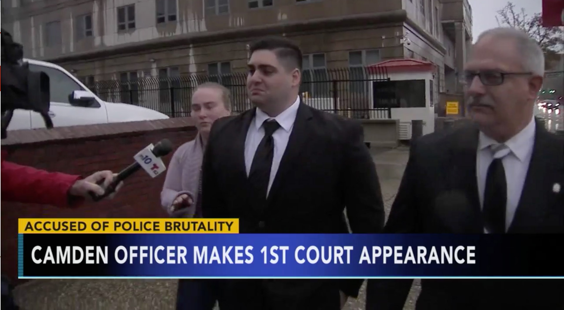 Camden County Police Officer Nicholas Romantino (center), 25, of Egg Harbor, was released on a $50,00 bond after a grand jury charged him with punching an unarmed suspect in the head.