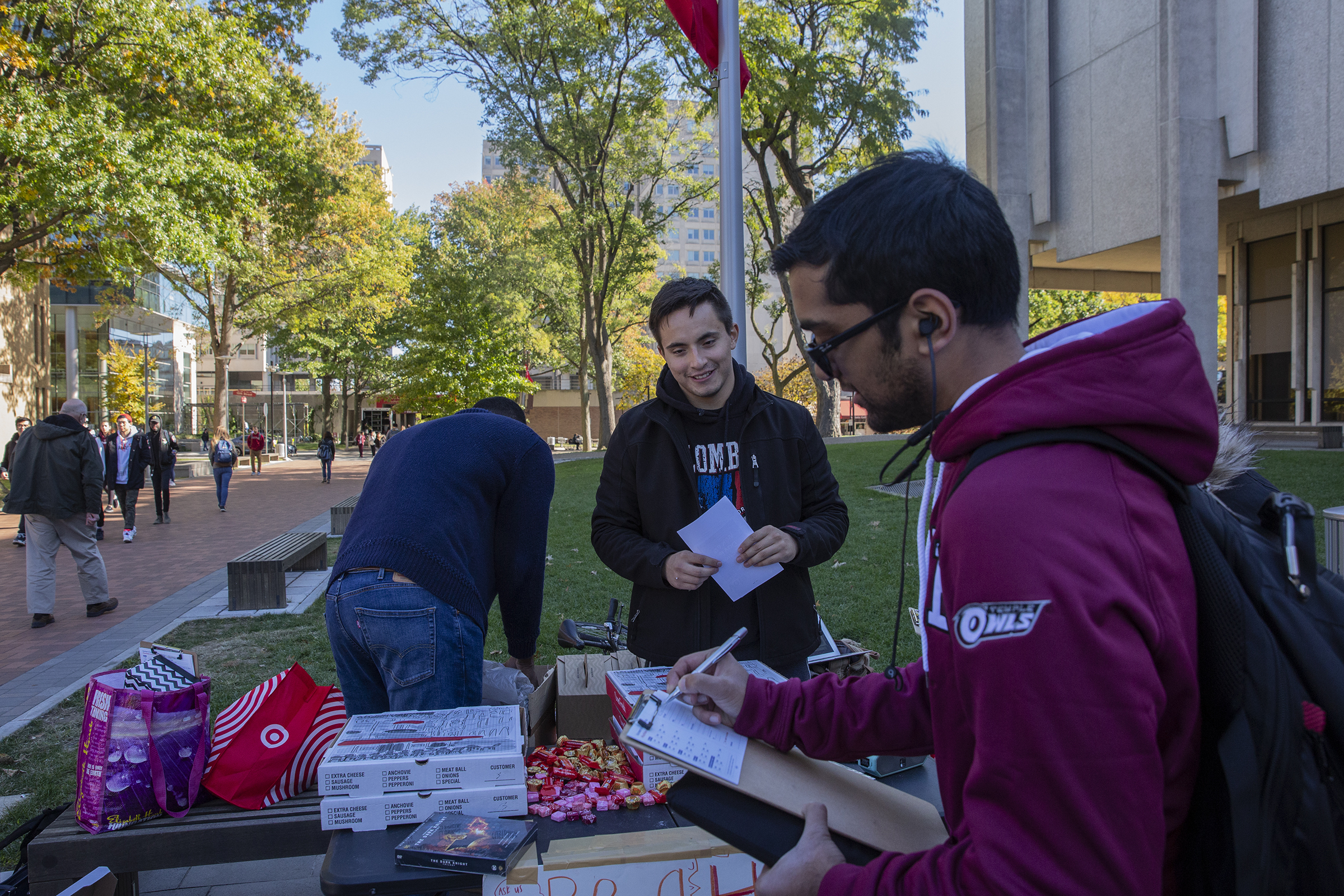 Sebastian Avila, center, encourages students to pledge to vote on Election Day next Tuesday at Temple University on Tuesday, Oct. 30, 2018. The goal was to ensure a massive young voter turnout next week.