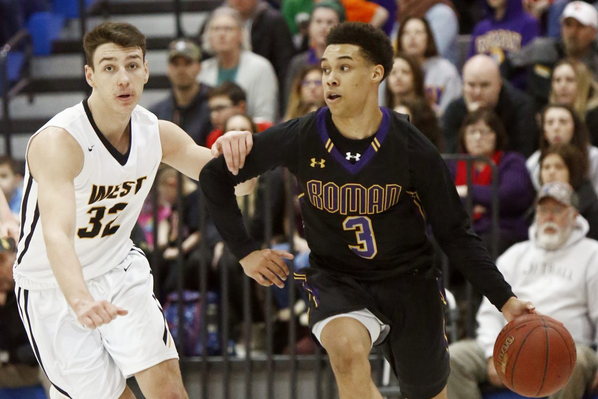 Roman Catholic point guard Lynn Greer III (3) drives the baseline against Central Bucks West's Collin MacAdams (32) in a PIAA Class 6A quarterfinal last season.