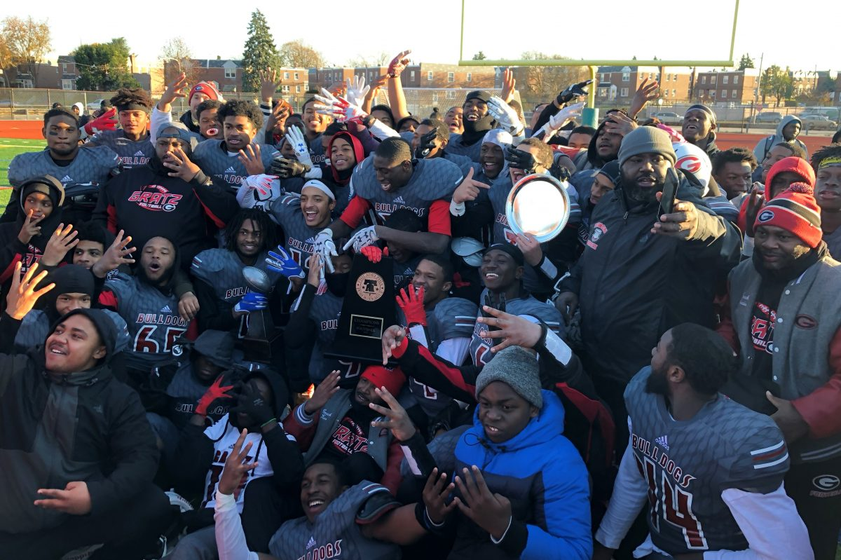 Gratz players celebrate after winning their fourth straight Public League football title on Saturday.