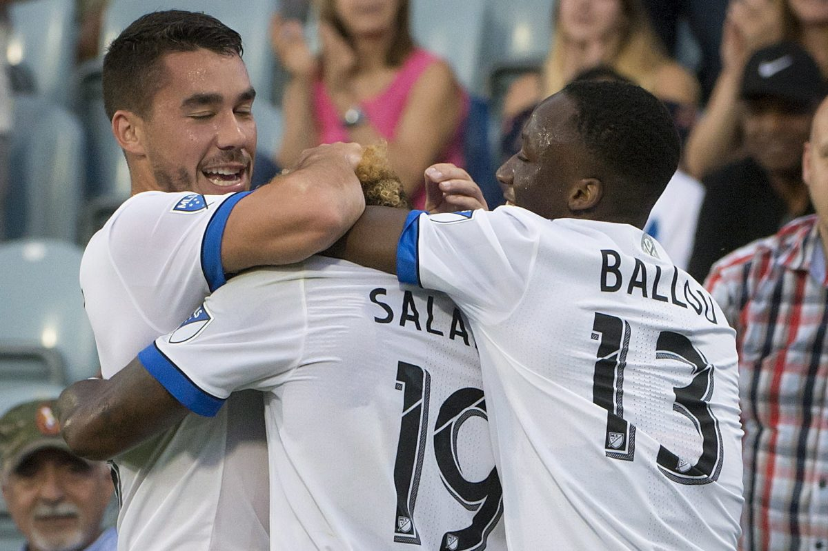 The Montreal Impact's Michael Salazar (19) is hugged by teammates after scoring against the Union on Wednesday.