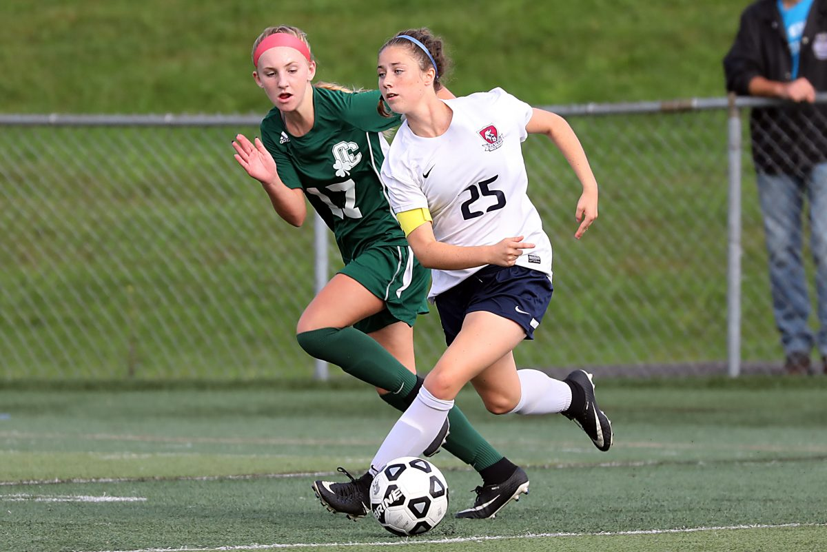 Eastern's Sara Brocious (right) chases the ball against Camden Catholic on Sept. 28.