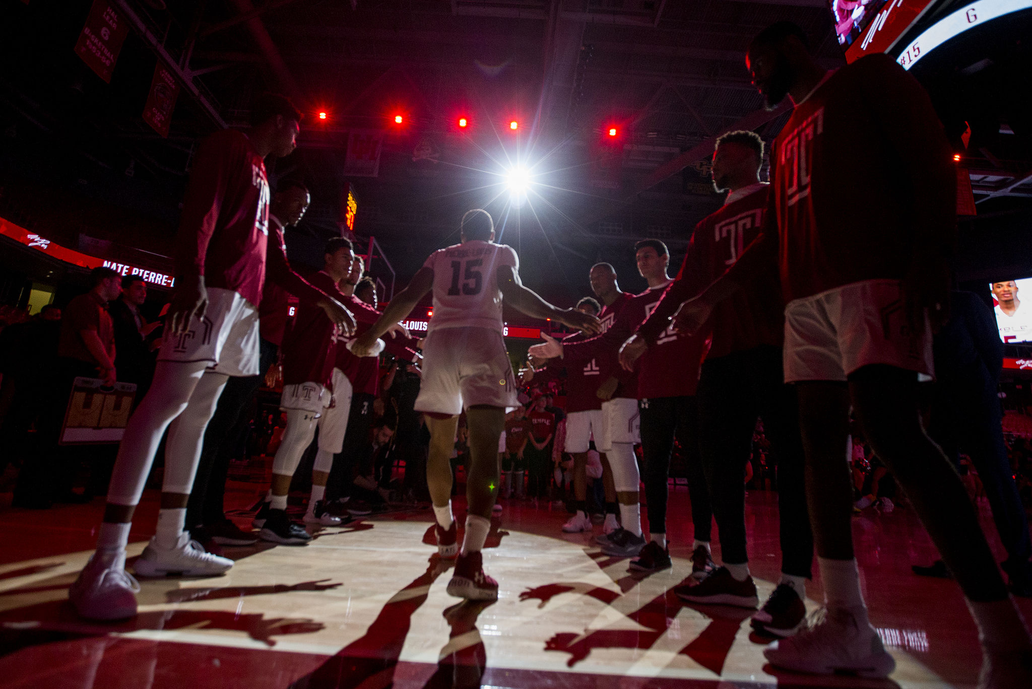Nate Pierre-Louis, center, of Temple is introduced as part of the starting line-up against Georgia at the Liacouras Center on Nov. 13, 2018.