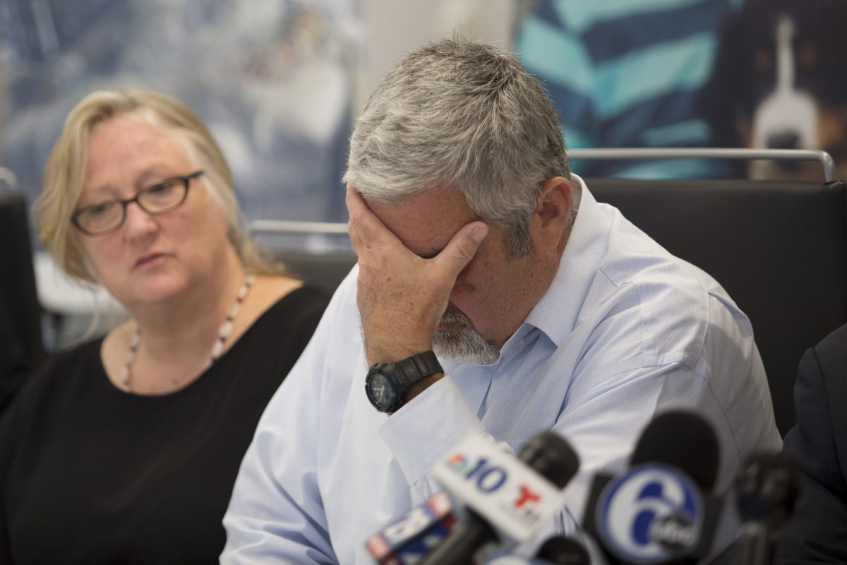 Roderick McGibbon, tears up at a press conference where he speaks of his son's , brain injury after  fraternity members failed to call 911.  (MARGO REED / Staff Photographer )