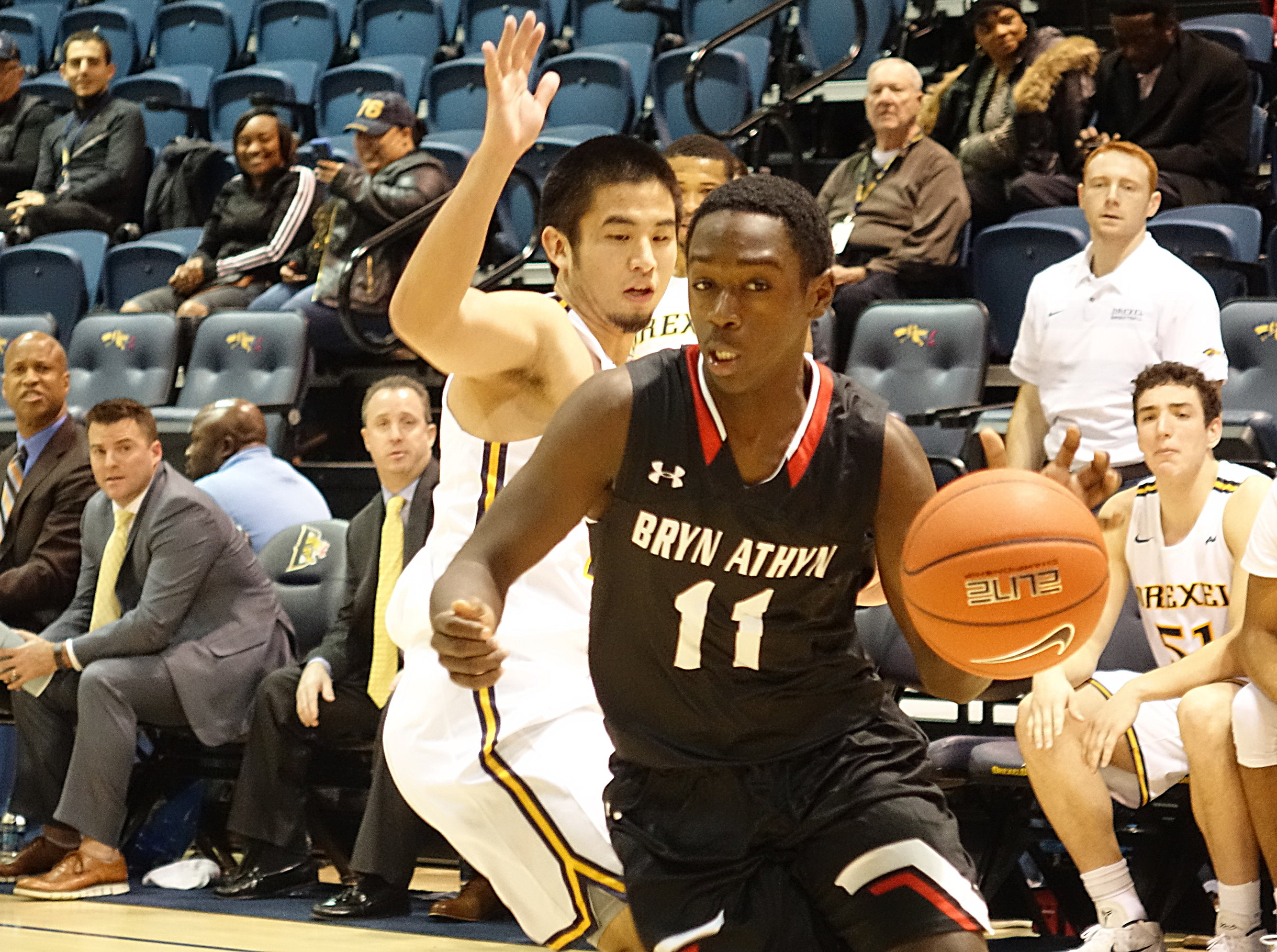 Bryn Athyn´s Tariq Moore drives baseline against Drexel´s Kevin Doi.
