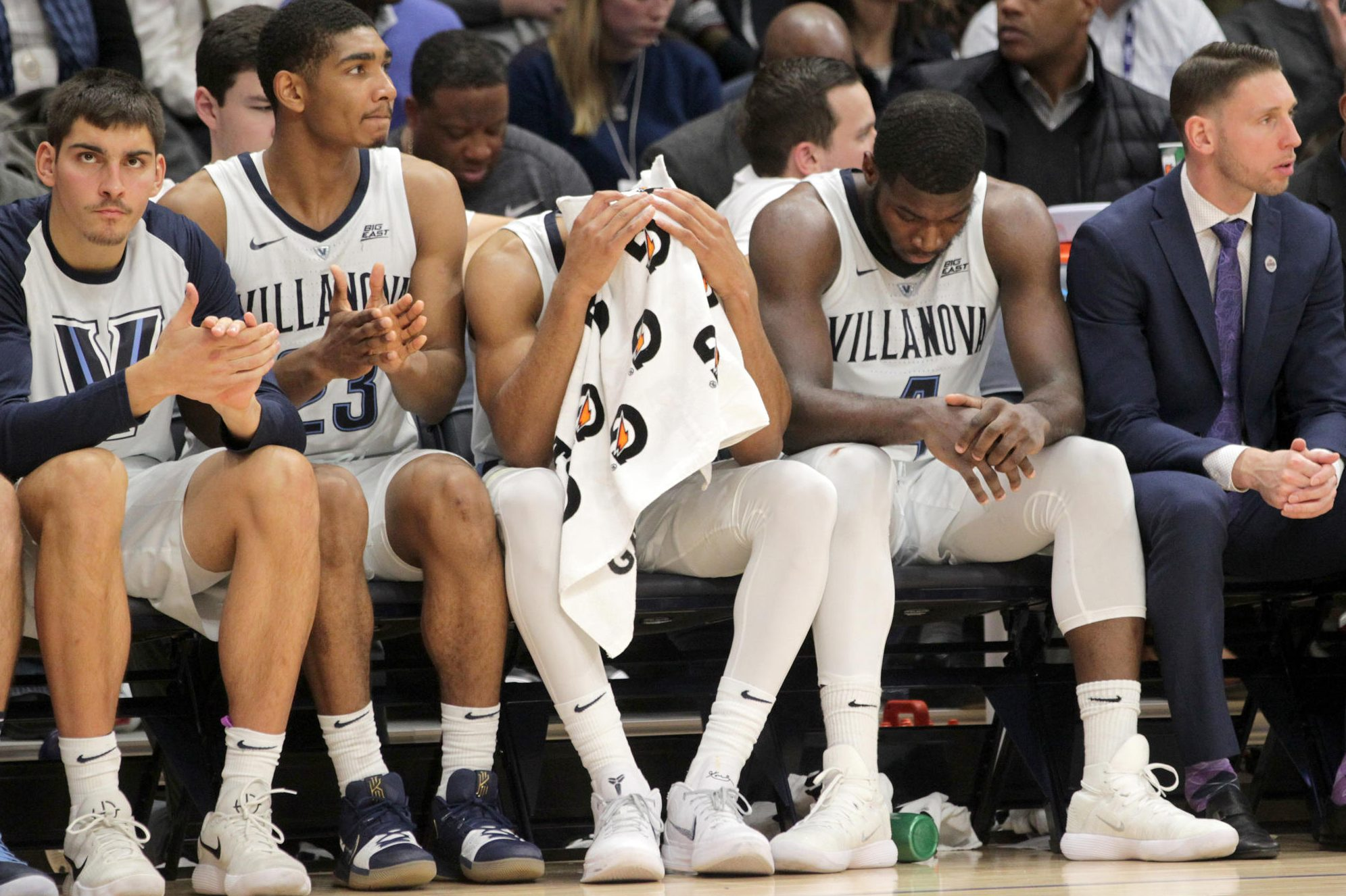 The Villanova team shows their dejection on the bench L-R: Dylan Painter, Jermaine Samuels, Phil Booth, Eric Paschall, and Assistant Coach Mike Nardi in the final minutes of their 73-46 loss to Michigan on Nov. 14, 2018 at Finneran Pavilion.