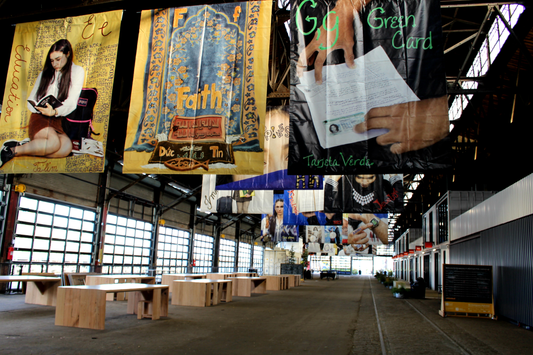"""""""An Immigrant Alphabet"""" art installation by artist Wendy Ewald and Northeast High School students hangs at the Cherry Street Pier in Philadelphia on Wednesday, Nov. 14, 2018."""