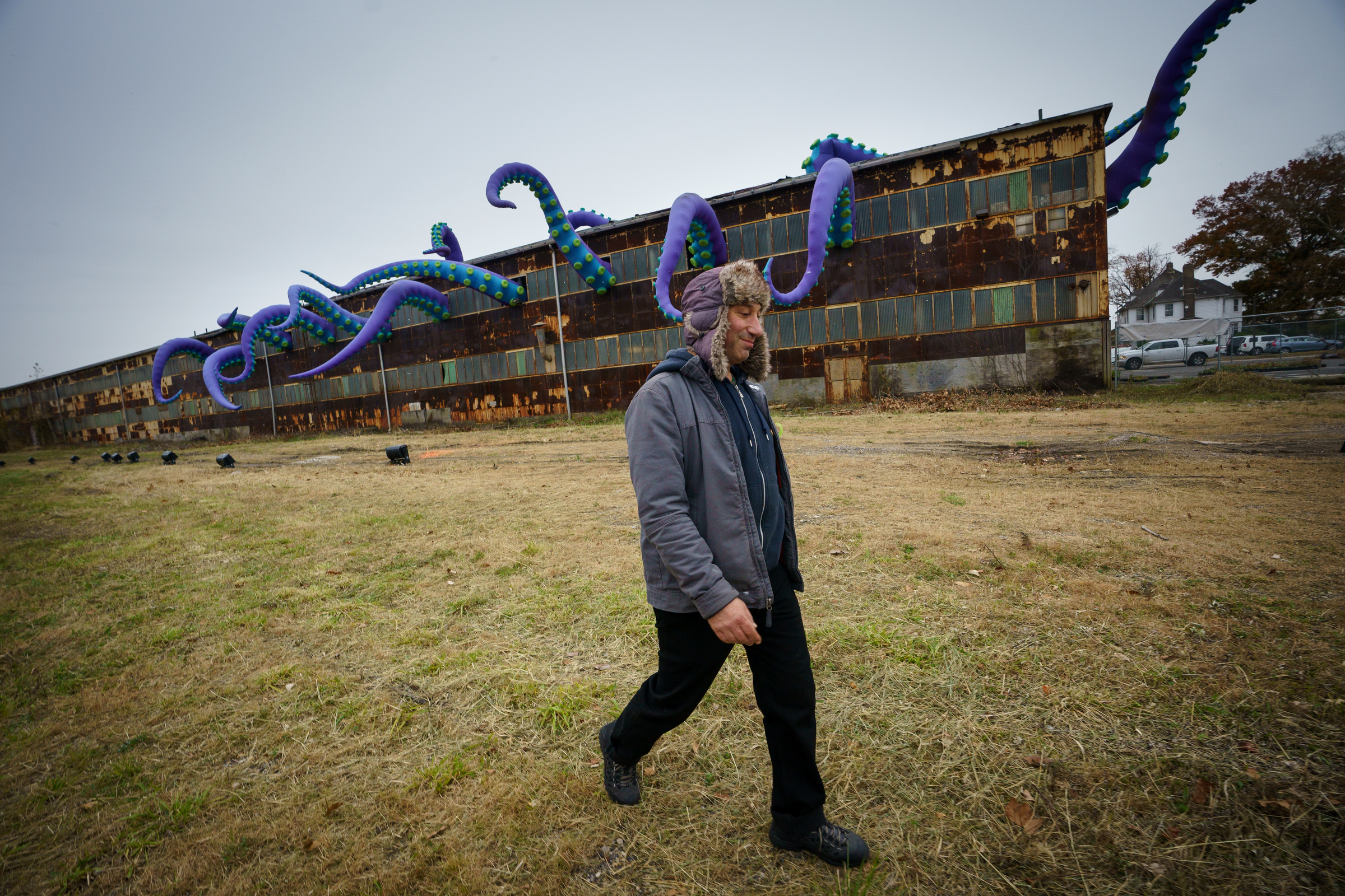 The maker and his massive monster installation.