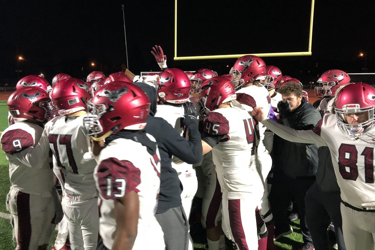 St. Joseph's Prep celebrates after defeating Northeast, 49-14, to capture the PIAA District 12 Class 6A title.
