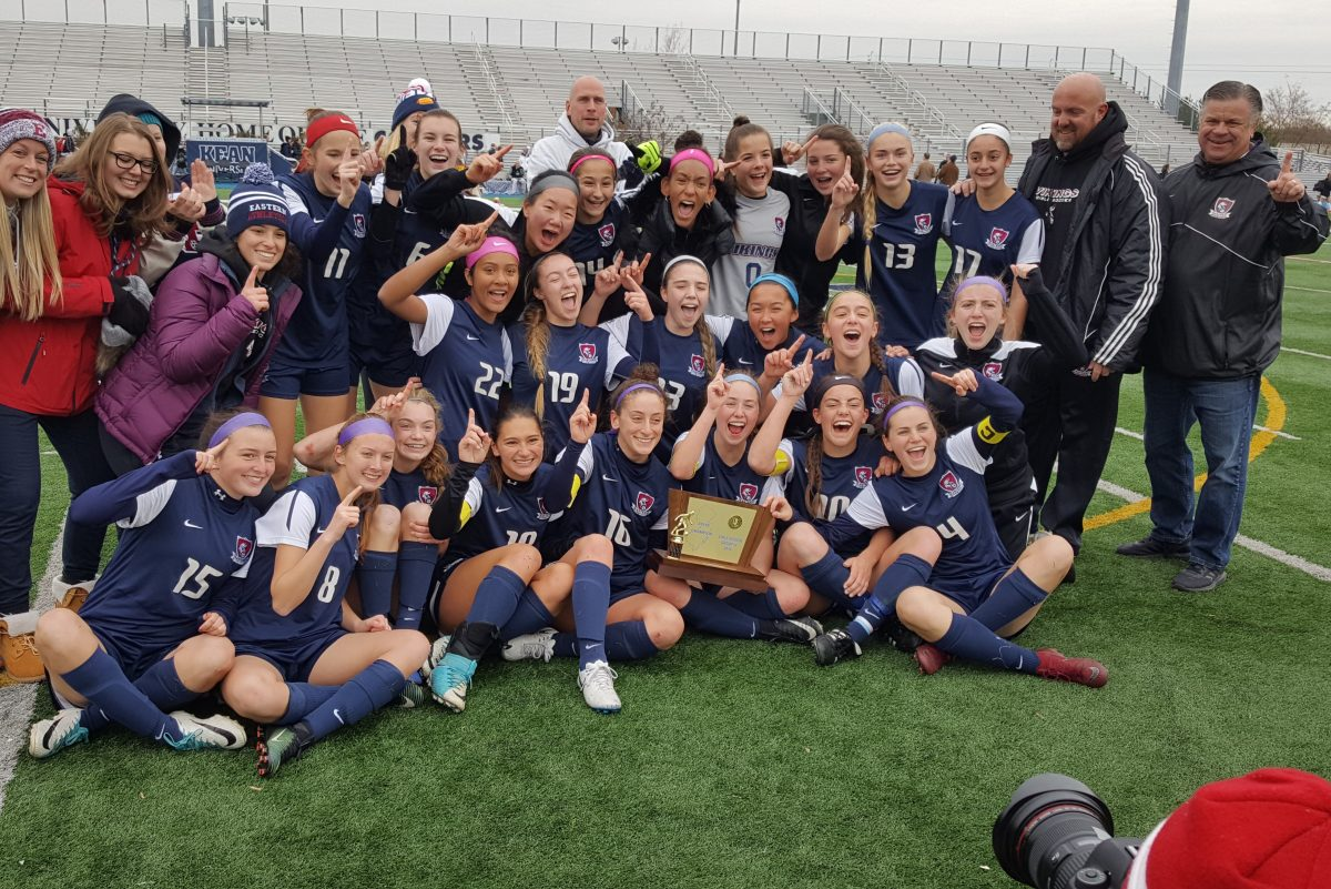 Eastern's girls celebrate the school's first state soccer title since 2006.