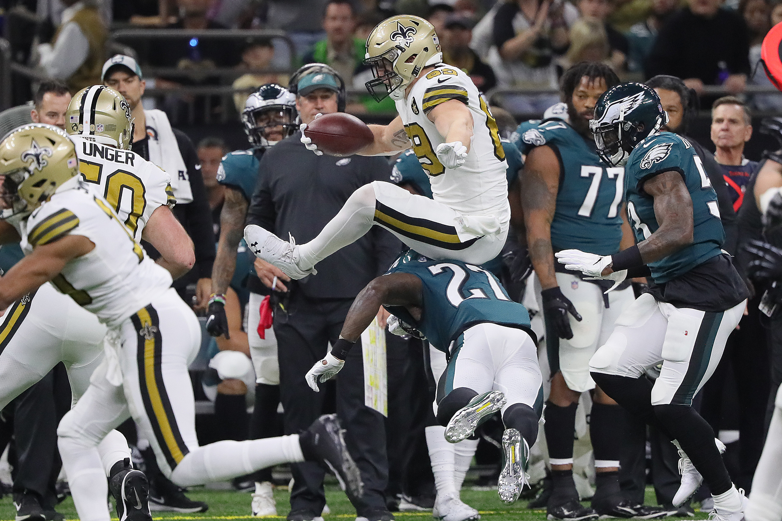 Josh Hill (center) leaps over Malcolm Jenkins in the first quarter. Jenkins was pretty much invisible throughout the Eagles´ loss on Sunday.
