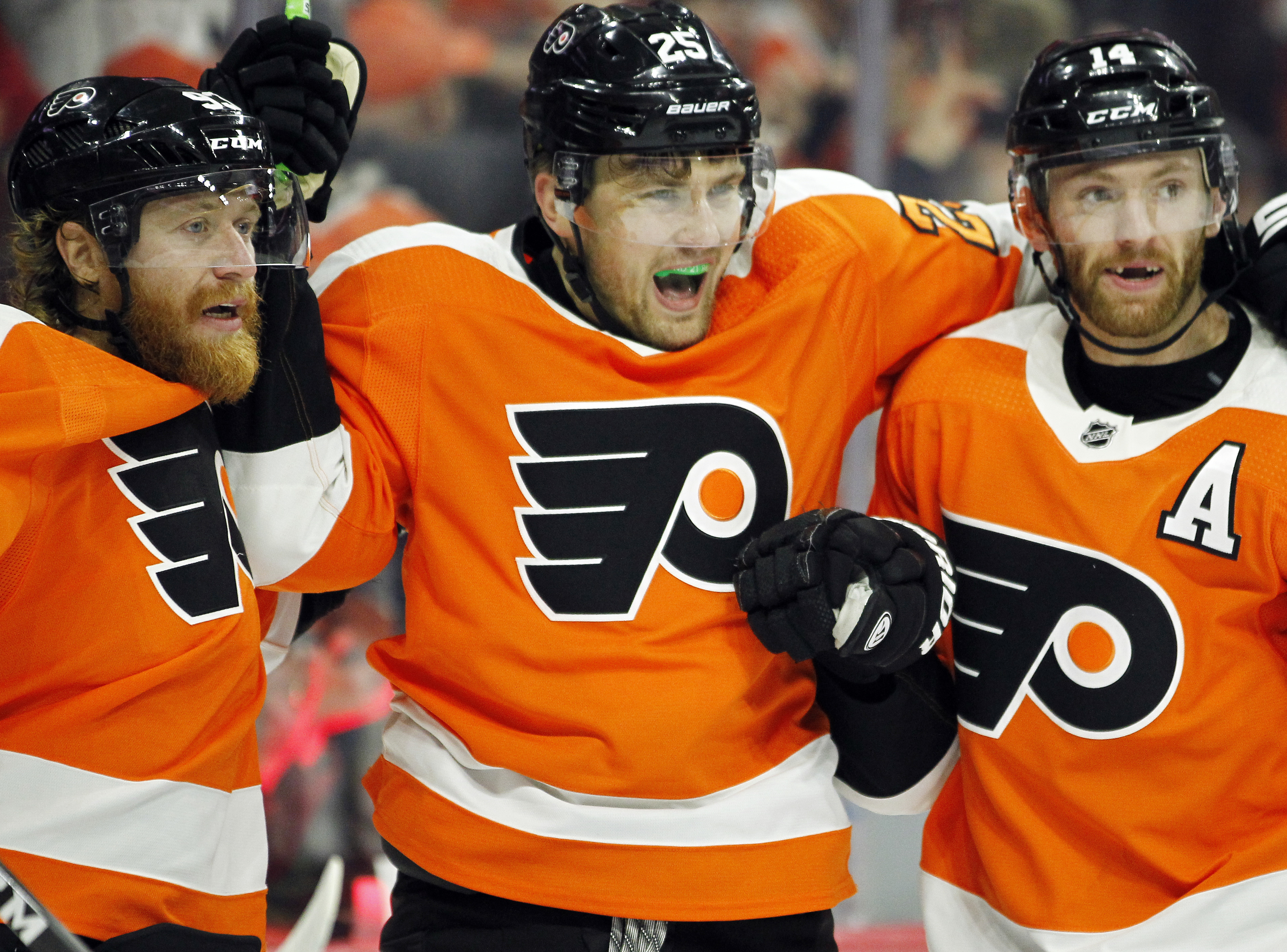 James van Riemsdyk, center, celebrating his goal Saturday with teammates Jake Voracek, left, and Sean Couturier.