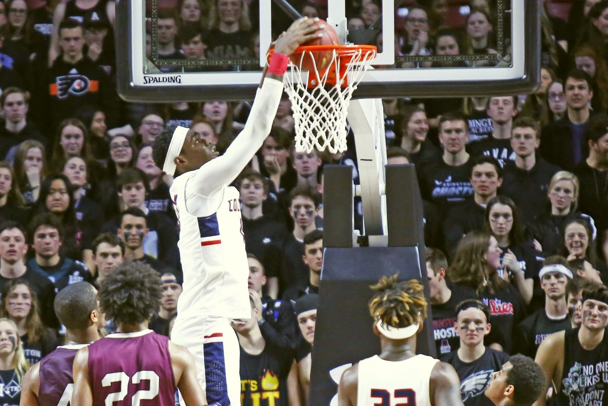 Plymouth Whitemarsh center Naheem McLeod dunks against Abington in last season's PIAA District 1 Class 6A championship game.