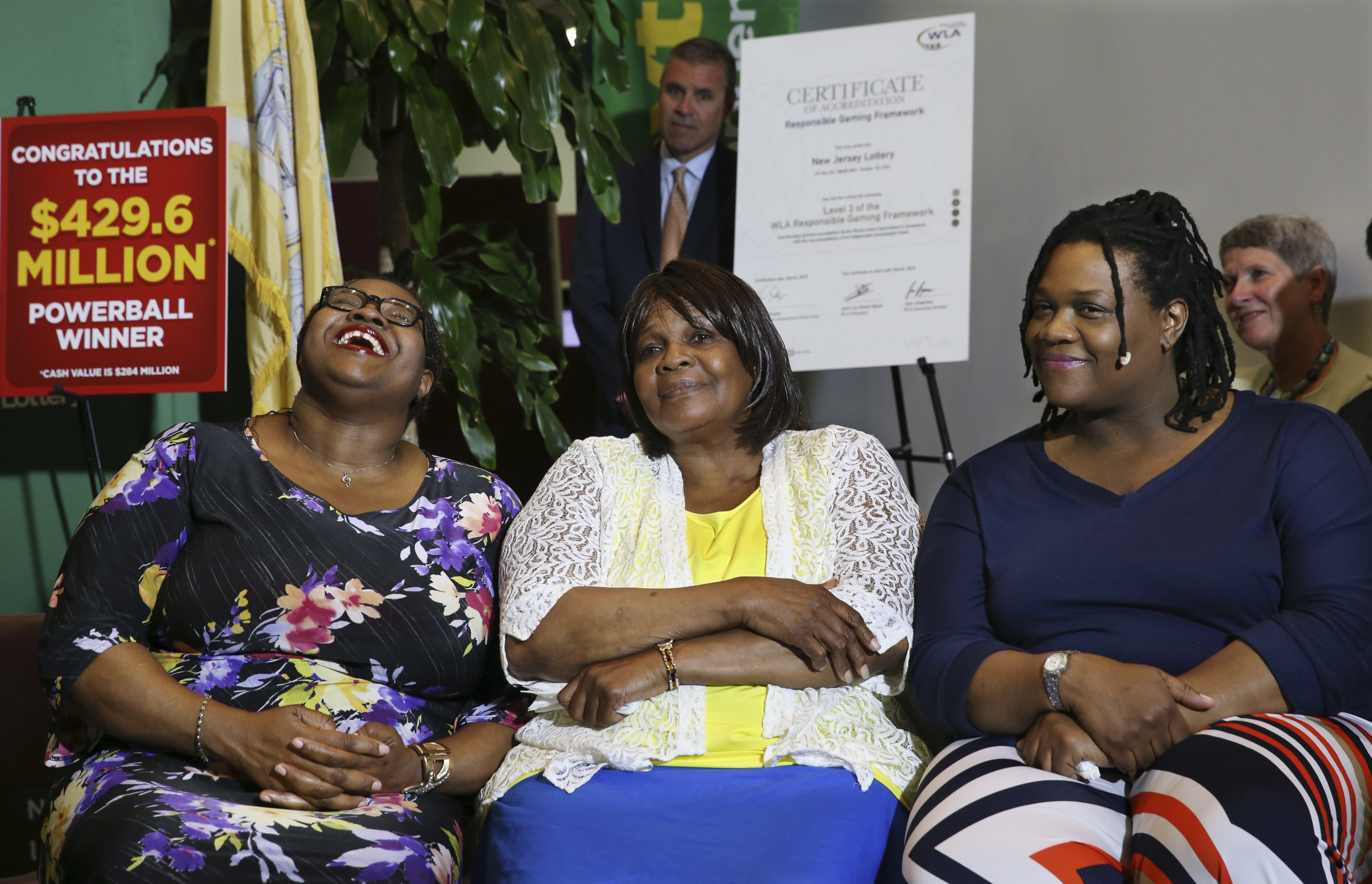 Pearlie Mae Smith, center, listens as she sits with her daughters as they talk about life after winning the lottery.