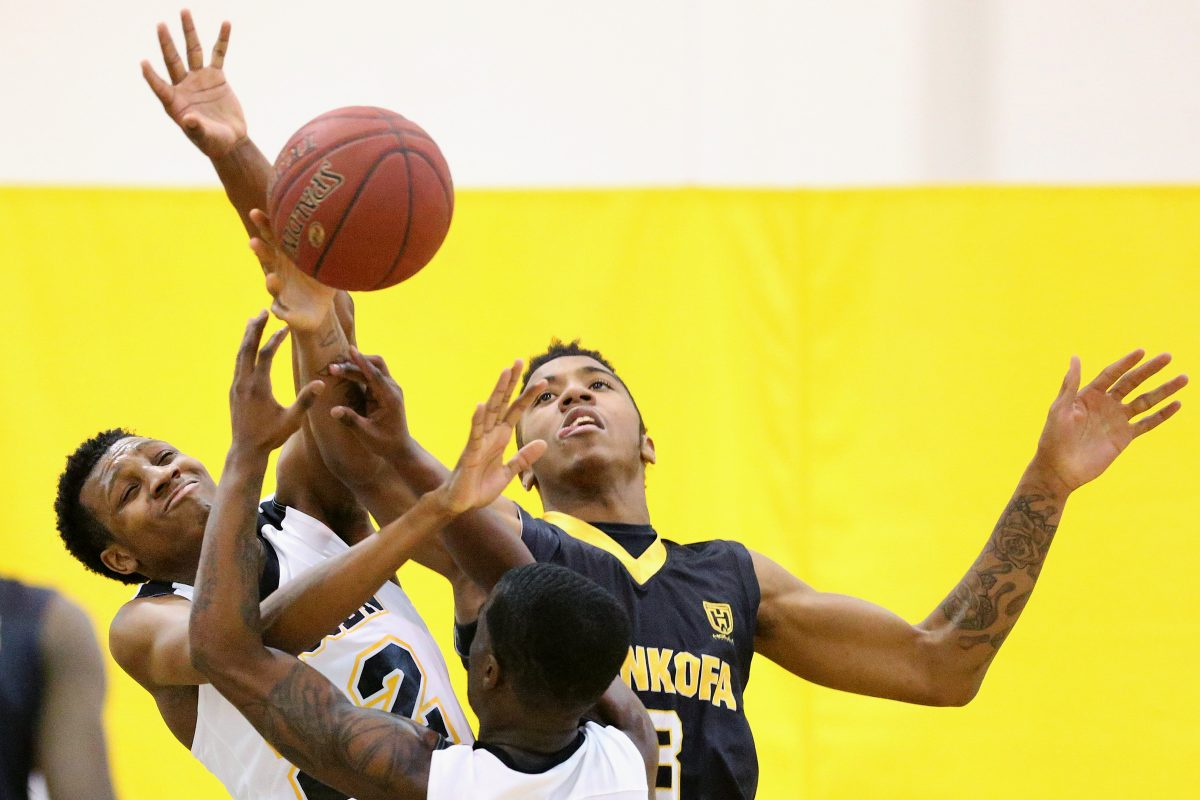 Sankofa's Khalil Turner (right) during a game against Abraham Lincoln last season.