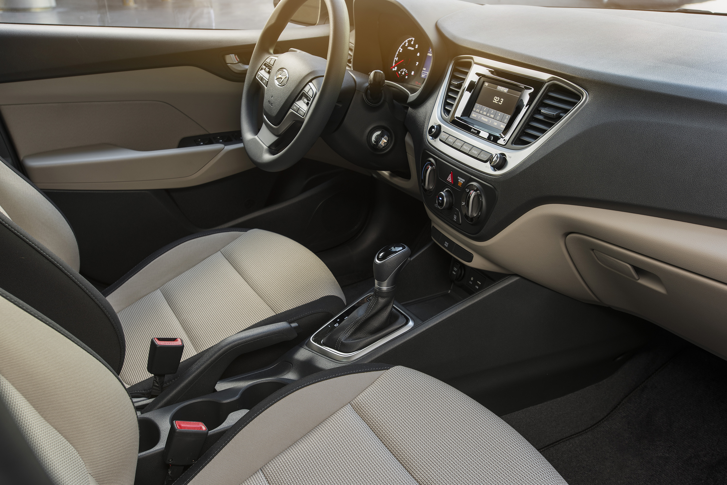The Hyundai Accent interior is barebones and rather unpleasant, although controls are easy and long trips not spinetingling.