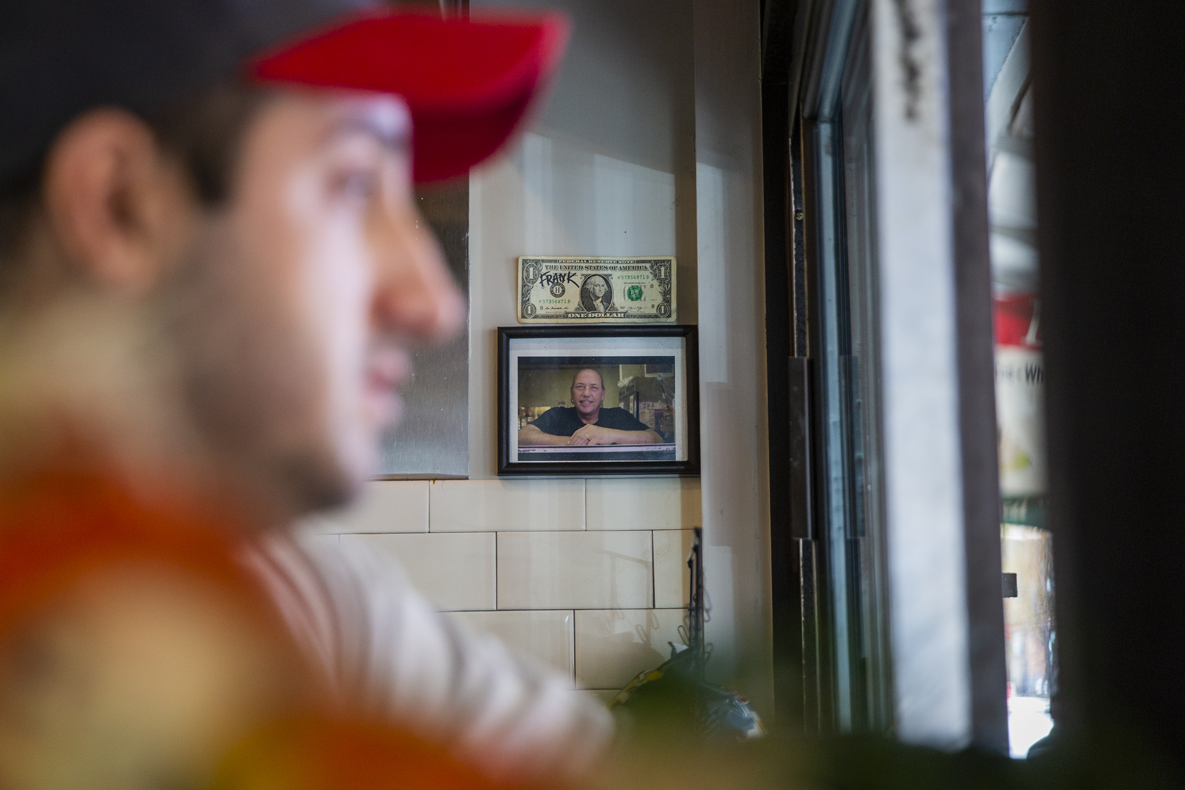 Jon Vellios keep a framed photo of his uncle, Mark Onorato, behind the grill. He ran the family owned sandwich shop on Ninth Strete for 30 years, before passing away from cancer last July.