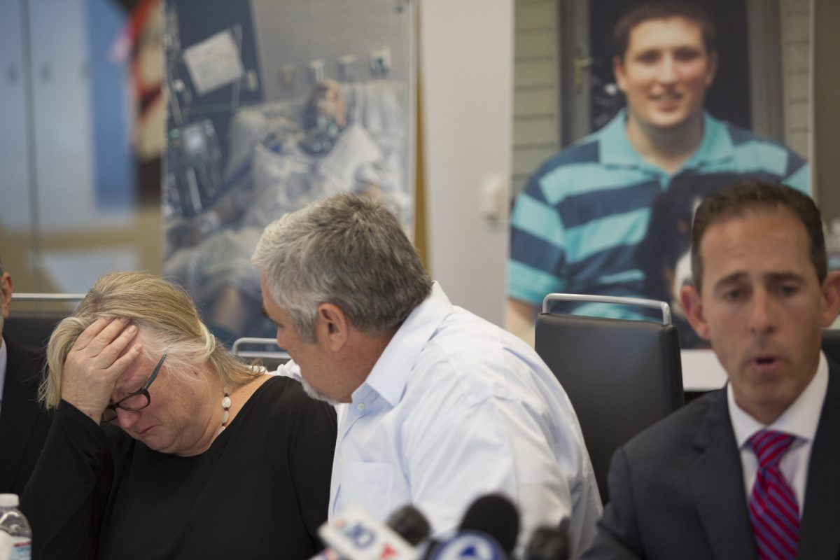 Elizabeth and Roderick J. McGibbon during press conference regarding son Ian's brain damage. Ian's parents have filed lawsuit.