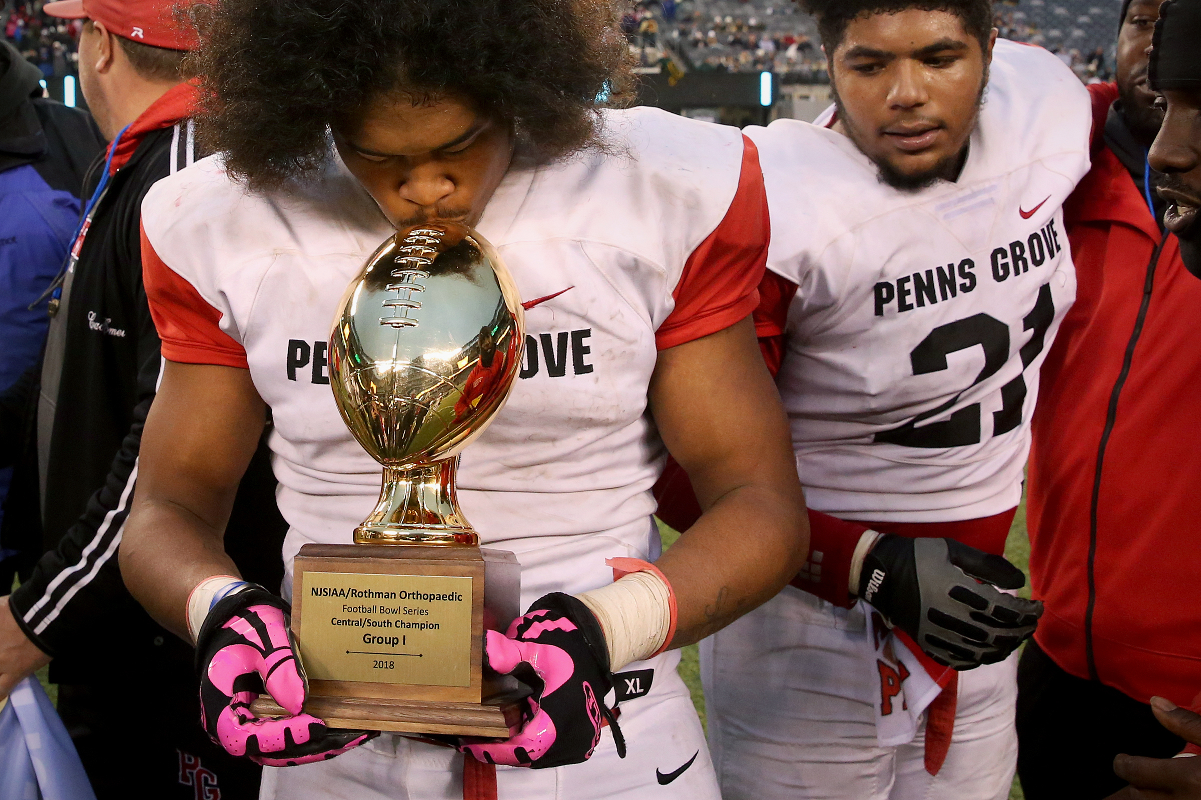 Penns Grove senior Tyreke Brown kisses the trophy after his team´s victory over Willingboro.