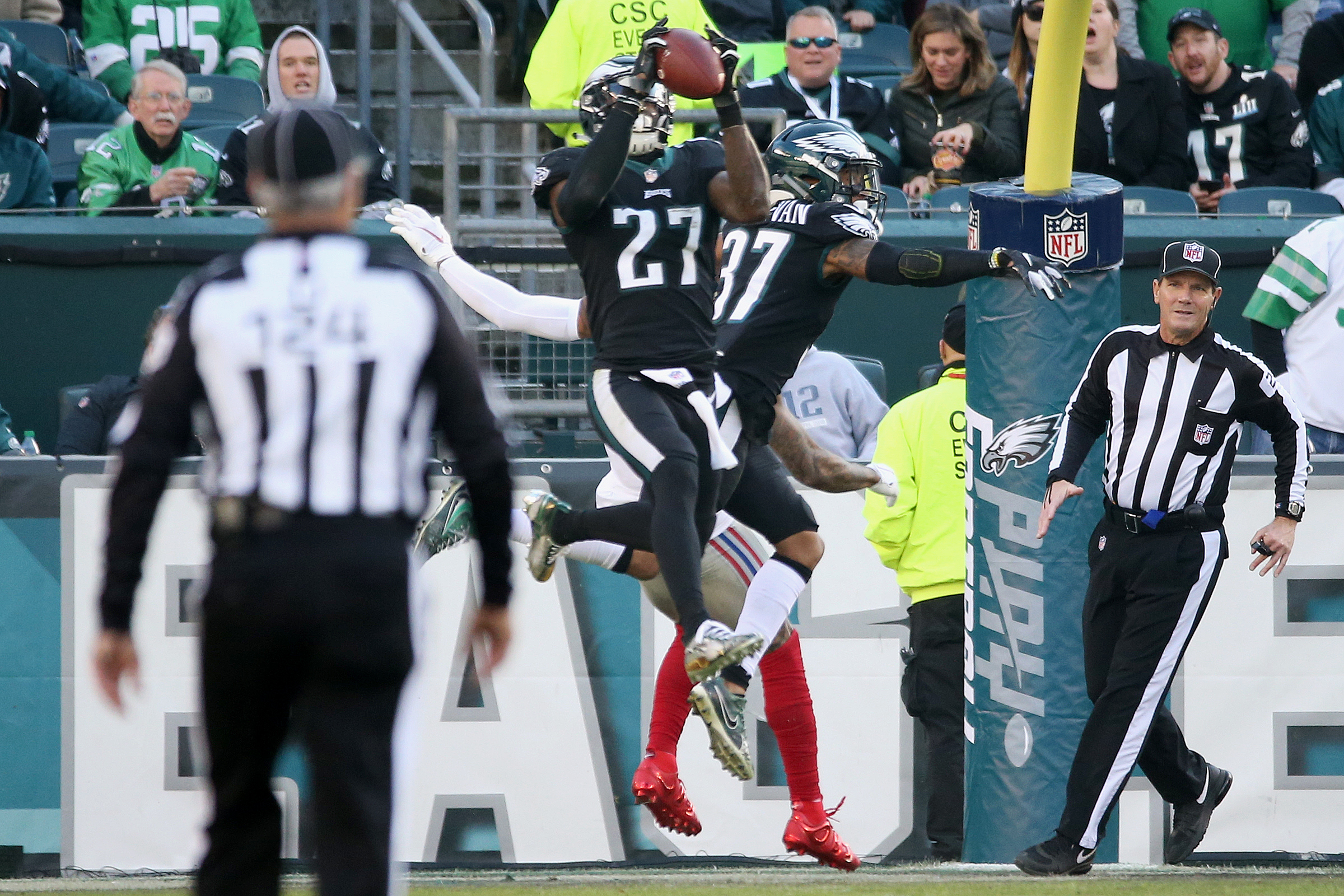Eagles safety Malcolm Jenkins (27) intercepts a pass at the end of the second quarter of a game against the New York Giants at Lincoln Financial Field in South Philadelphia on Sunday, Nov. 25, 2018.