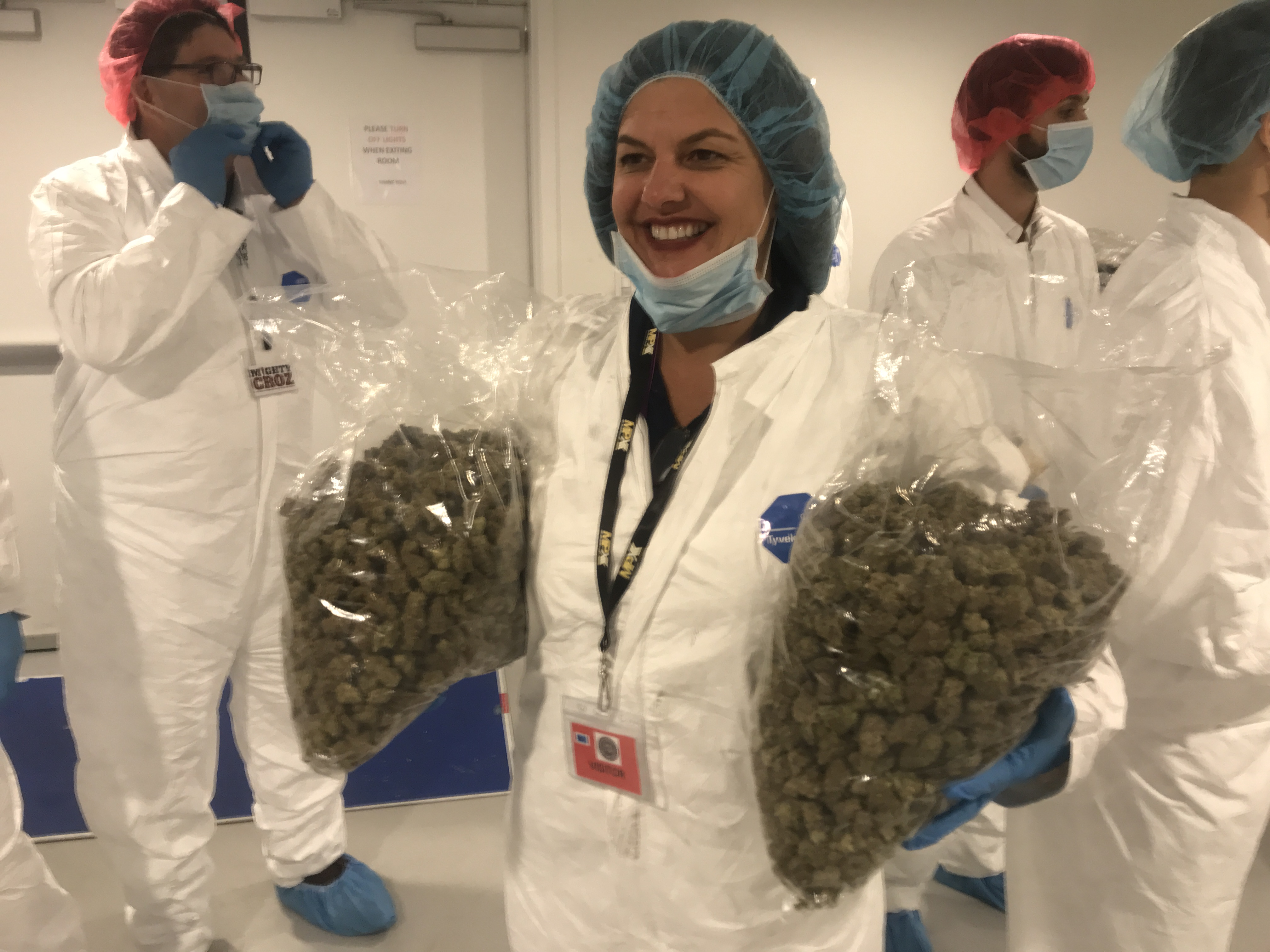 """Chris Visco, Pennsylvania´s Queen of Cannabis, took a tour of the iAnthus marijuana grow in North Las Vegas in mid-November. Here she holds two bags of flower. Asked how much that represented in sales at her TerraVida shops, she quipped """"Not even a week."""""""