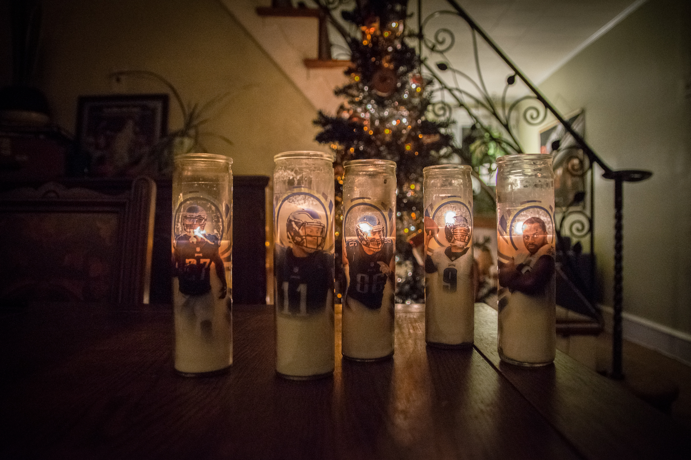 Stephanie Ricci at her home in Philadelphia on Friday, November 30, 2018 with her Eagles prayer candles. Ricci designs the candles and lights them for good luck during Eagles games.