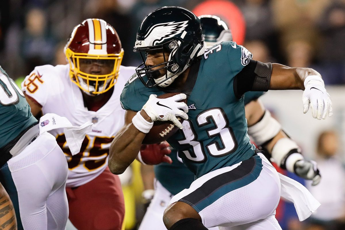 Eagles running back Josh Adams runs with the football past the  Washington defense during the first-quarter on Monday, December 3, 2018 in Philadelphia.