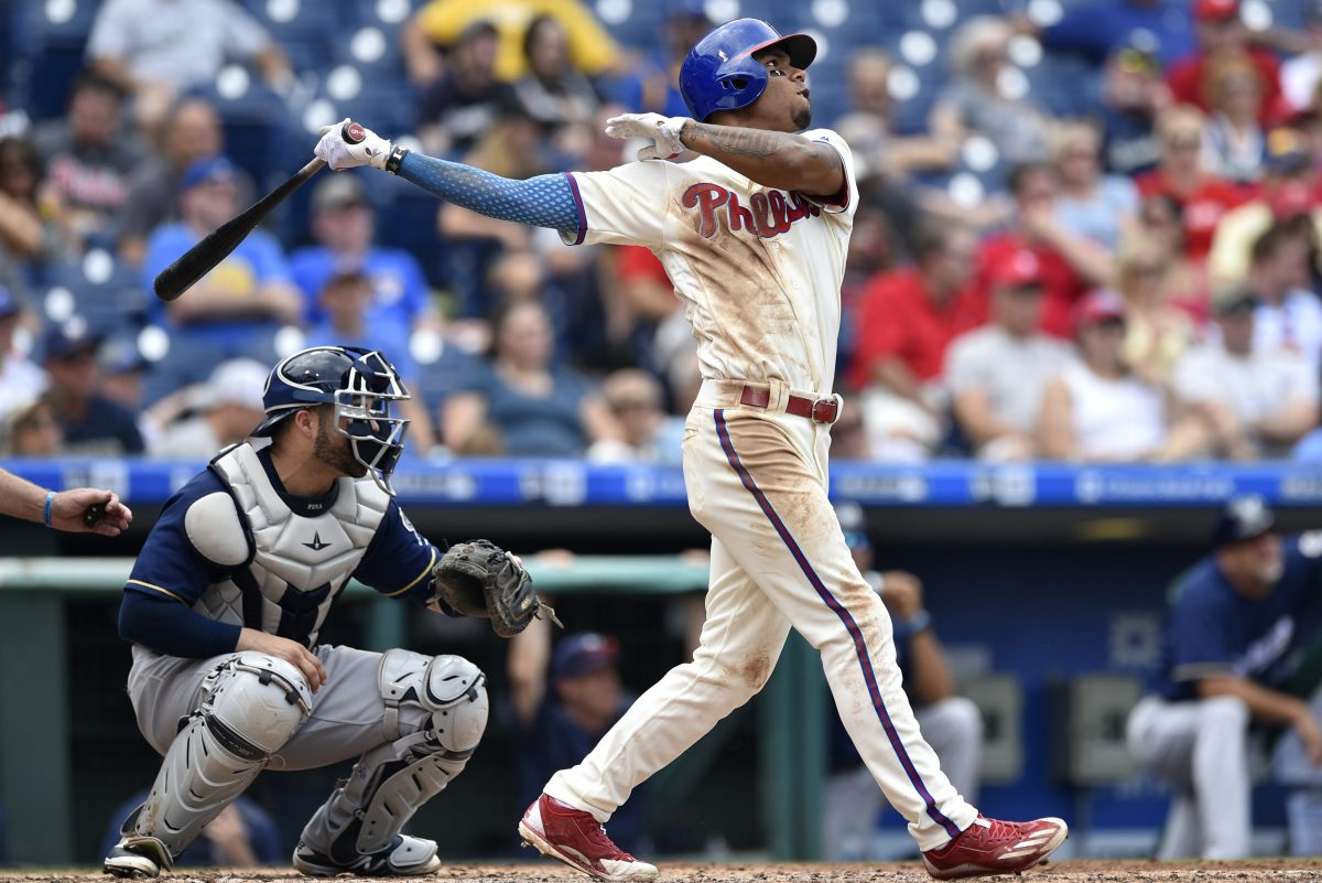 Philadelphia Phillies' Nick Williams, right, watches his two-run home run off Brewers pitcher Junior Guerra during the fourth inning of the Phillies 6-3 win.