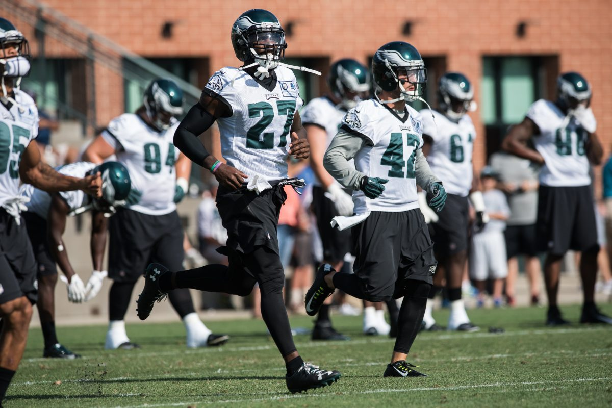 Philadelphia Eagles safety Malcolm Jenkins (27) runs next to teammate Chris Maragos (42) during during last year's training camp at the NovaCare Complex.